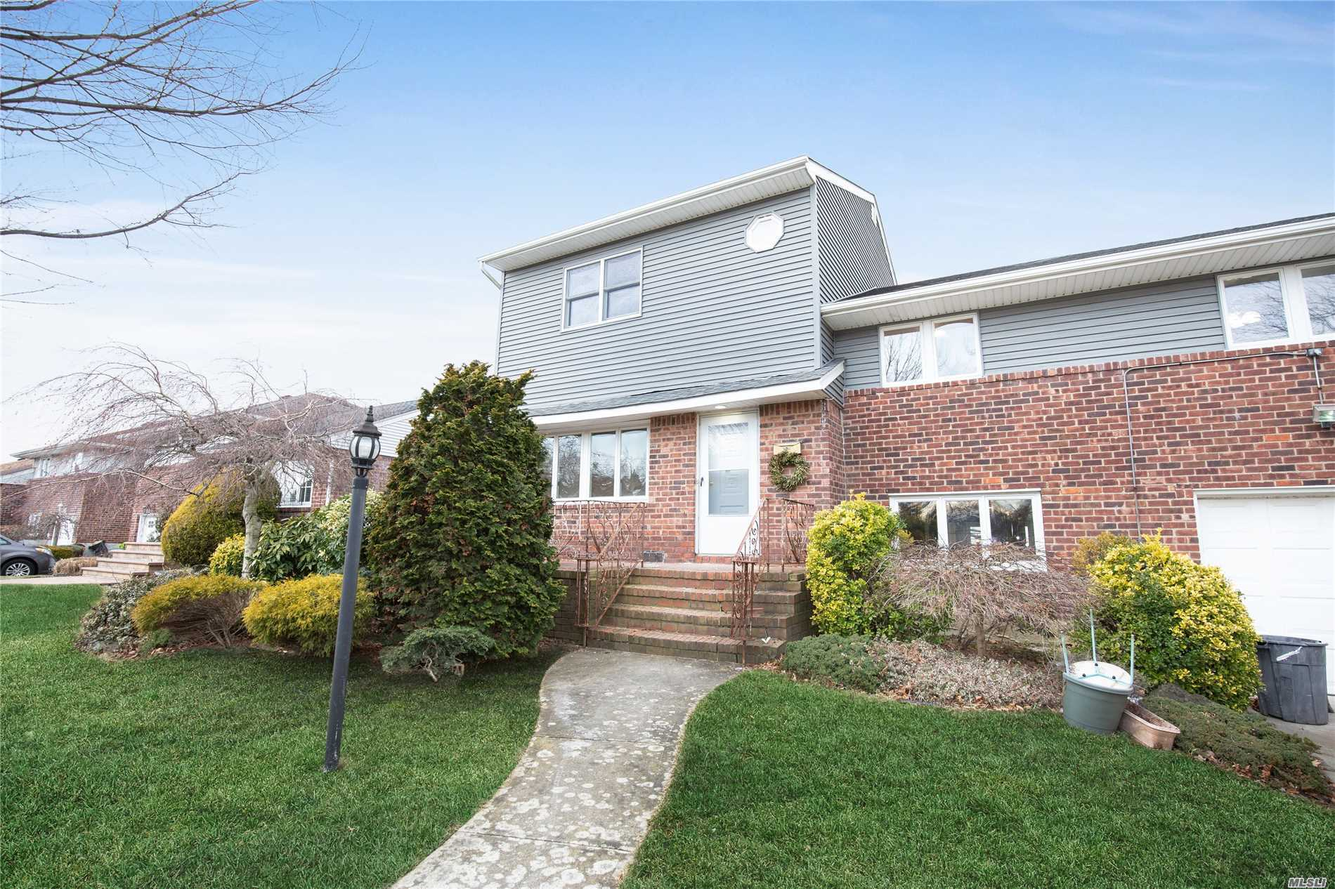 Completely Renovated! One Of A Kind Expanded Split! Open Layout W/Lr, Dr, & Lg Eat In Kitchen W/Huge Island! Ss Appliances, Quartz Counters &Sliders To Rear Deck. Main Level: Family Room W/Wood Burning Fpl &Outside Access As Well As A Den W/Wetbar, Powder Room, Laundry, &Garage Access.Upstairs:Jr Mstr Suite W/Cedar Closet &Full Bth. Add'tl 2 Bed & Full Bath. Dormered Master Bed Suite W/His&Her Walk In Closets, Luxury Master Bath W Radiant Heat Floors! Manor Elem. See Attached Floor Plan!