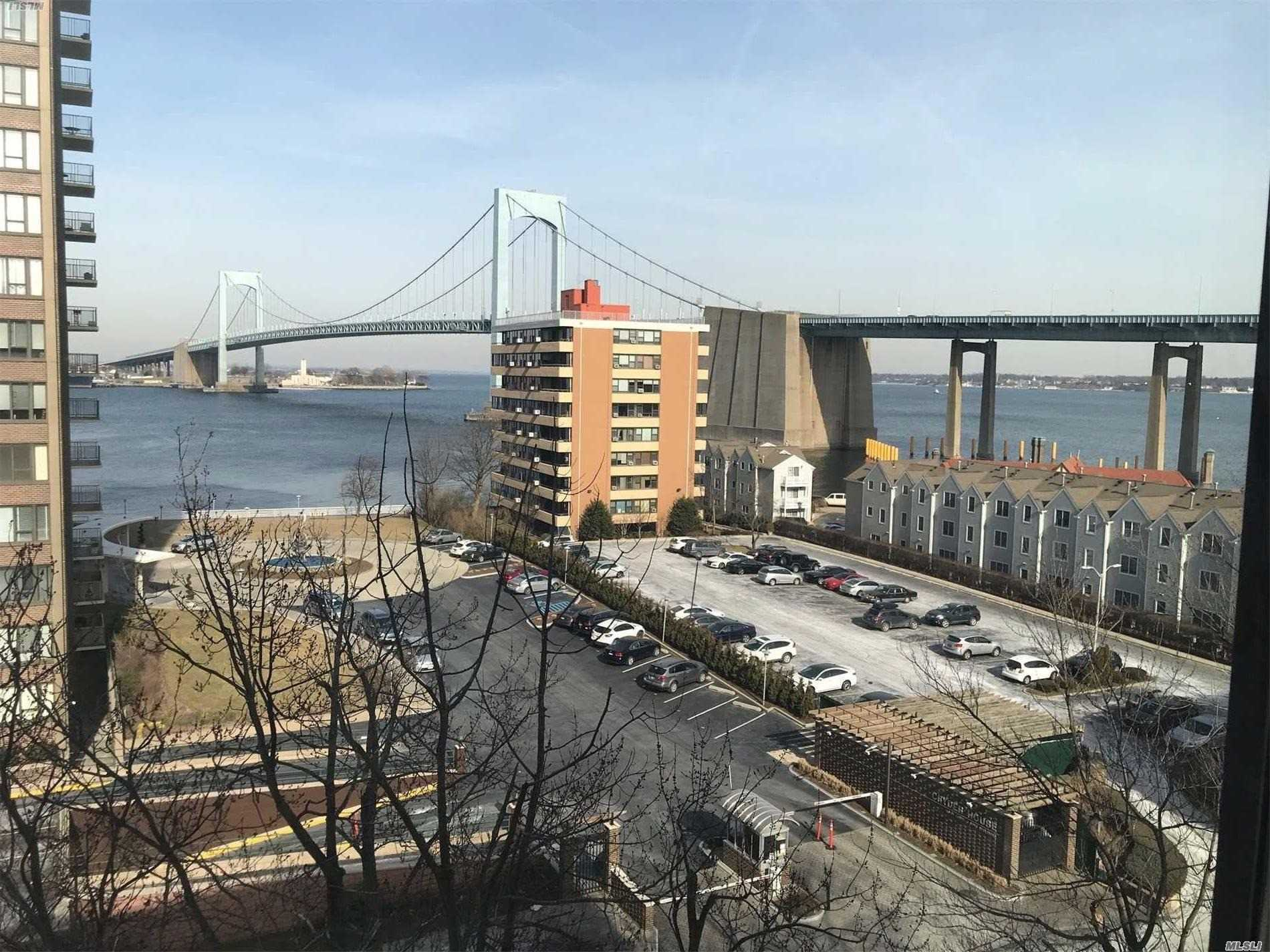 Location Location...Waterfront At Its Best...Panoramic Water And Bridge Views From Every Window ... Renovated Kitchen With Oak Cabinets And Corian Counter Tops....Engineered Hardwood Floors In Living Room And One Bedroom...Updated Bath...Prime Parking Available For Transfer M41