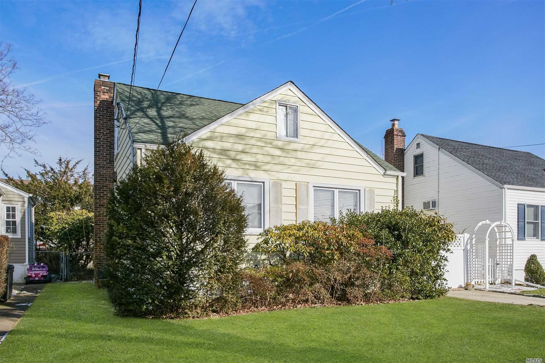 Charming Cape Cod In Desirable Quiet Street, Very Bright And Sunny. 3 Bedrooms, With New Marble Bathroom,  15 Year Roof, Anderson Window, Everything Renovated 6 Years Ago. Finished Basement, 3 Zone Heating And Camera Wire Ready. 5 Mins To Lirr. 10 Mins To Express Train, 3 Mins To Shopping Center, 6 Min To Bus Stop Connect To Jamaica Subway. Hillside Grade Elementary And Memorial High.