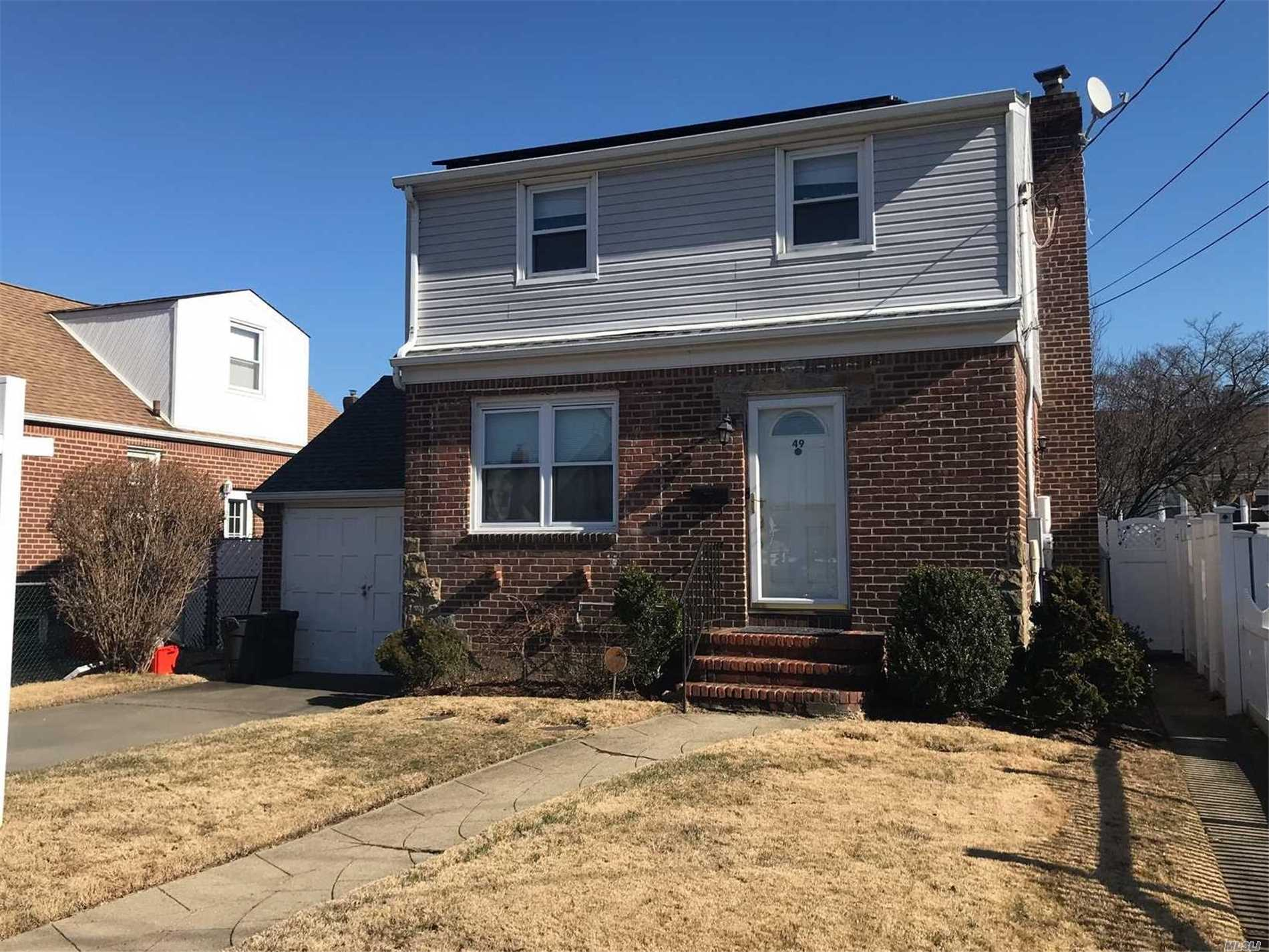 Light And Bright Cape With Full Basement. New Oil Tank, New Hot Water Heater, New Basement Windows, Close To Transportation, Parks And Shopping. Hardwood Floors Throuhout. Slider Glass Doors To Large Private Backyard. One Car Garage With Parking In Driveway.