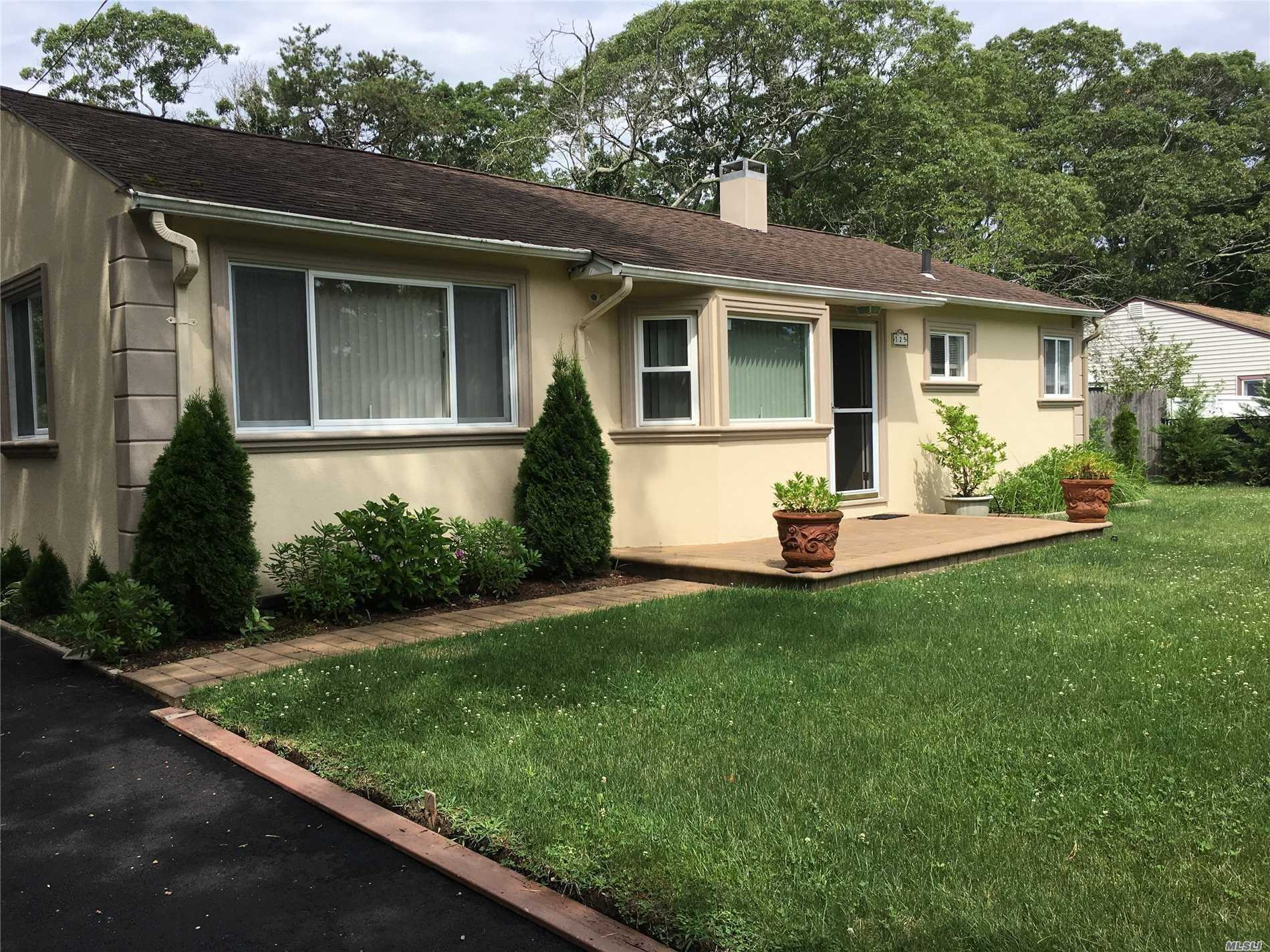 Beautiful Redone Ranch With A Lovely Yard. Mature And Lush Landscaping Surround The Paver Stone Patio With Awning. Large Detatched Garage. Feet From Lovely Peconic Bay Views In Waterfront Community.