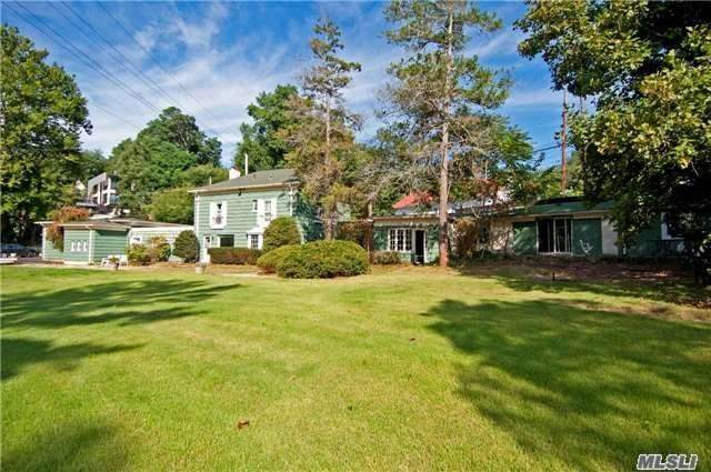 A Must-See Exquisite Legal 2 Family House Situated On 2.22 Acre Land With All-Season Natural Creek. This Property Consists Of 3 Parts, Main: Lr, Eik, 3 Brs, 2 Fbths; Western: Lr, Fr, Br, Fbth; Eastern: Lr, Fr, Eik, 2 Brs, Fbth, Ideal For An Extended Family. 1 Family With 4 Bedrooms, 1 Family With 2 Bedrooms, Next To Engineers Country And Swan Clubs,  1.3 Miles To Lirr, Great Neck-Flushing Bus Cross Street, Top 100 Best Community To Live In America, Price To Sell!