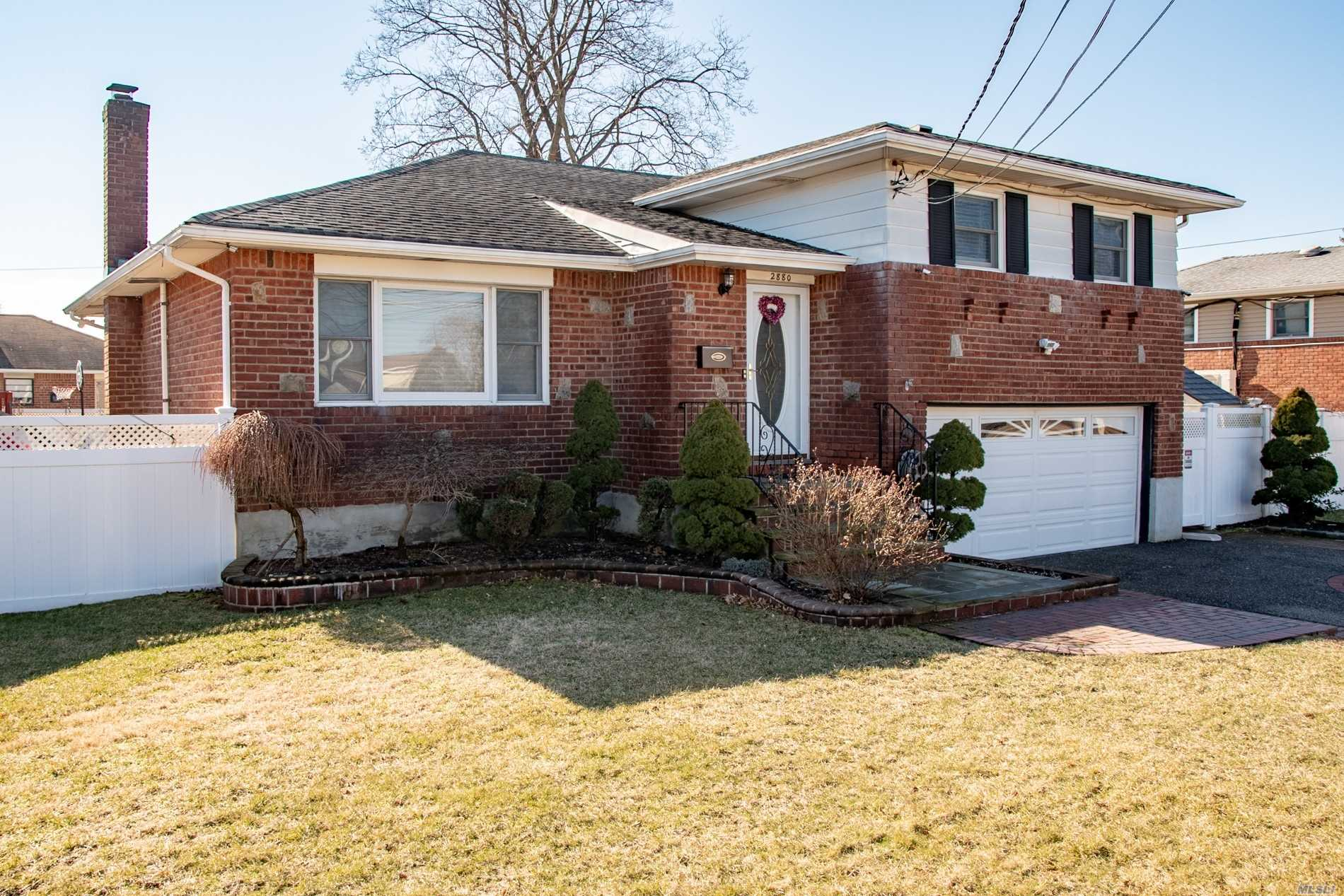 Stunning Brick Split Located On A Quiet Street. The Home Has An Open Layout With Gleaming Hardwood Floors, Tastefully Updated Kitchen & Baths, Brand New Gas Heating System, Central Air, In-Ground Sprinklers, And A Beautifully Maintained Private Yard With Pavers And Pvc Fence.