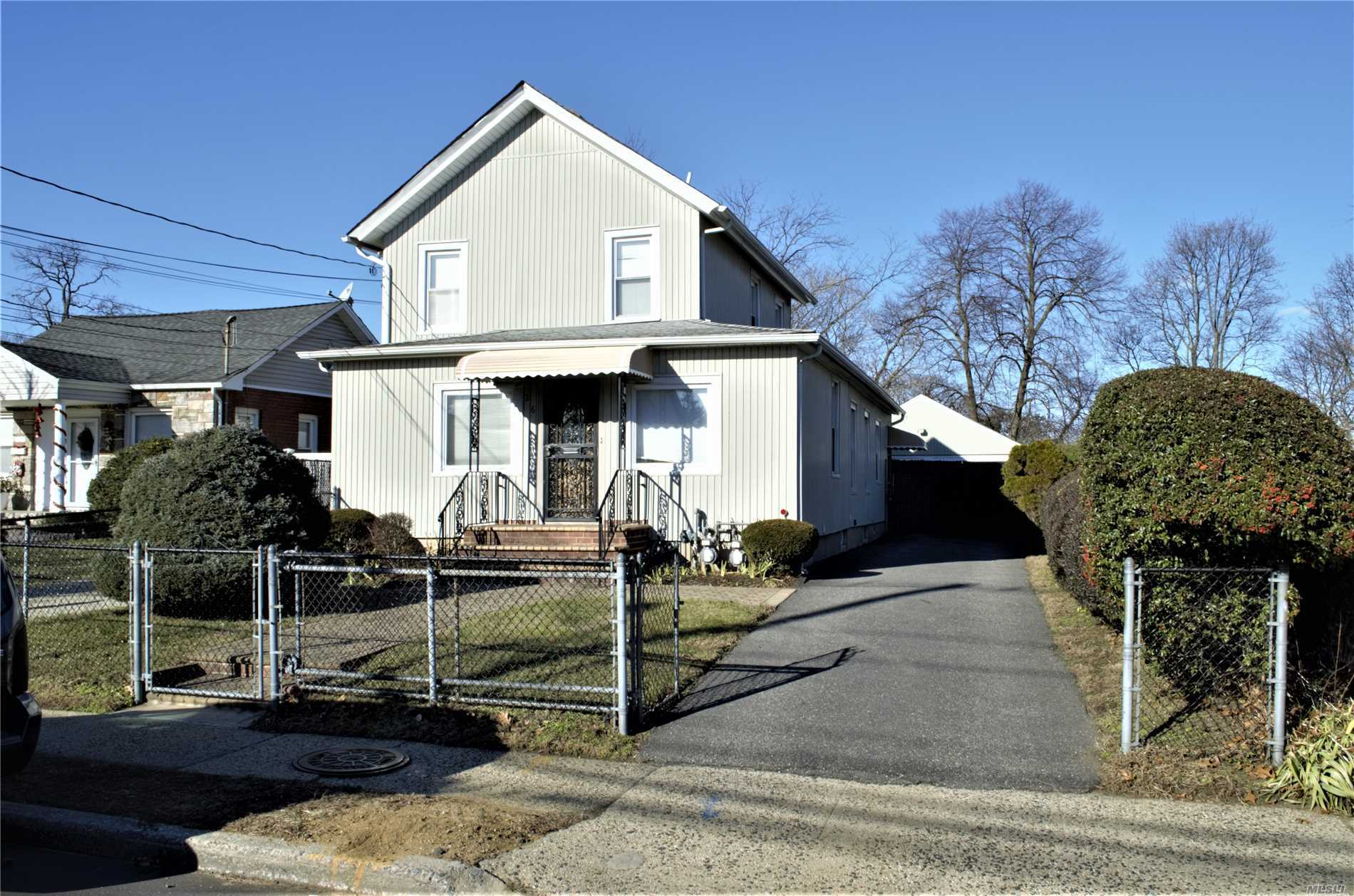 Legal 2 Family House. Large 187 Ft. Deep Lot. 2 Bedrooms Down. One Up. Second Floor Has A Large Deck Of The Bedroom W/Skylight. Full Finished Basement. Large 2 Car Garage. 2 Private Driveways. Great Location. Lot Size 50X187. Low Taxes. Close To Schools And Transportation.