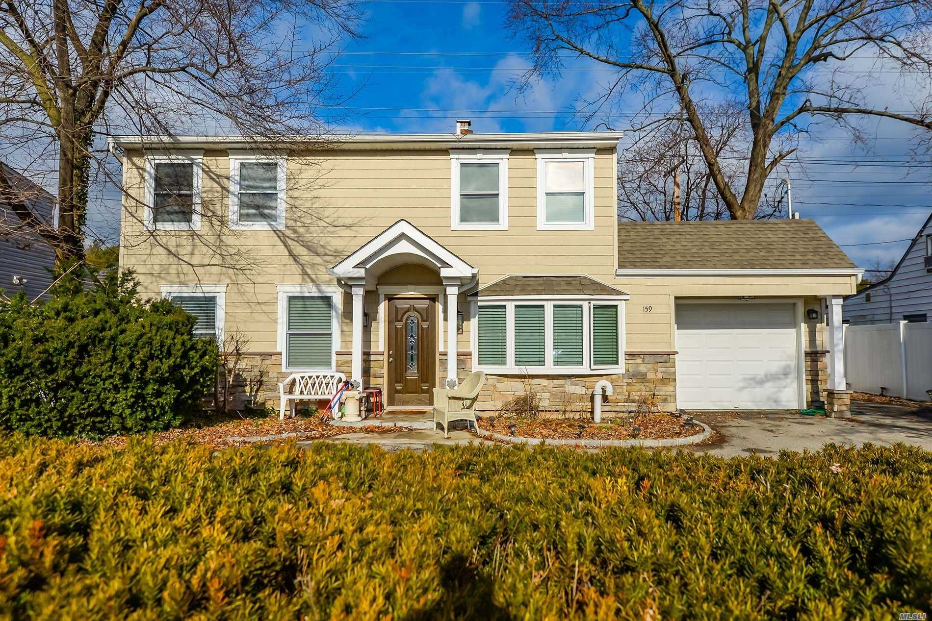 Beautiful All Renovated Colonial , New Windows, New Granite Counter Tops, Eat In Kitchen, Stainless Steel Appliances, Updated Heating System, New Above Ground Oil Tank , Main Floor Brand New Full Bath, Second Floor Beautiful Jacuzzi Marble Full Bath , Large Bedrooms Huge Deck On The 2nd Floor, Over Sized Yard, 1 Car Garage, Could Be Mother And Daughter With Proper Permits.