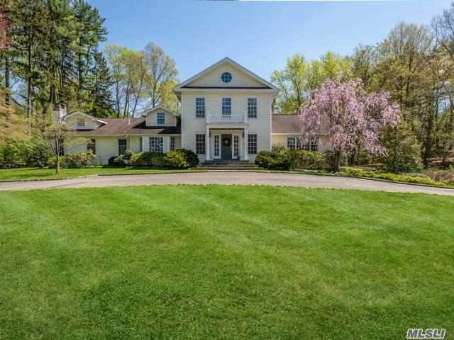 Completely Renovated And Expanded In 2002 This Colonial Boasts 5 Bedrooms And 4.5 Baths. This Charming Residence Is Situated On 2+ Acres In Lattingtown Harbor With 1st Floor Master Suite, Full Bath & Sitting Rm W/Fireplace, 28' Ceilings In Great Rm & Entr. Lg Eik, Great Room, Formal Dining & Potential In-Law Suite. Lower Level Has Radiant Heat. Wine Rm, Mudrm And Attached 3 Car Garage. Speakers Thruout The Entertainment Rooms. Our Own Beach And Beach House!