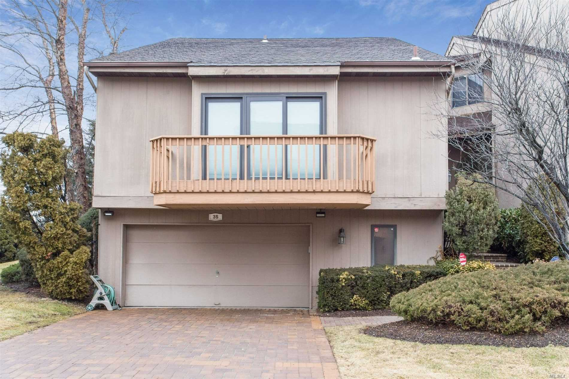 One Of The Largest Units In The Development With A High Ceiling For A Natural Light. Further Into The Complex This Unit Boasts Updated Bathrooms And Kitchen, Wood Floors, Lots Of Custom Made Closet, A Two Car Garage And Much More.