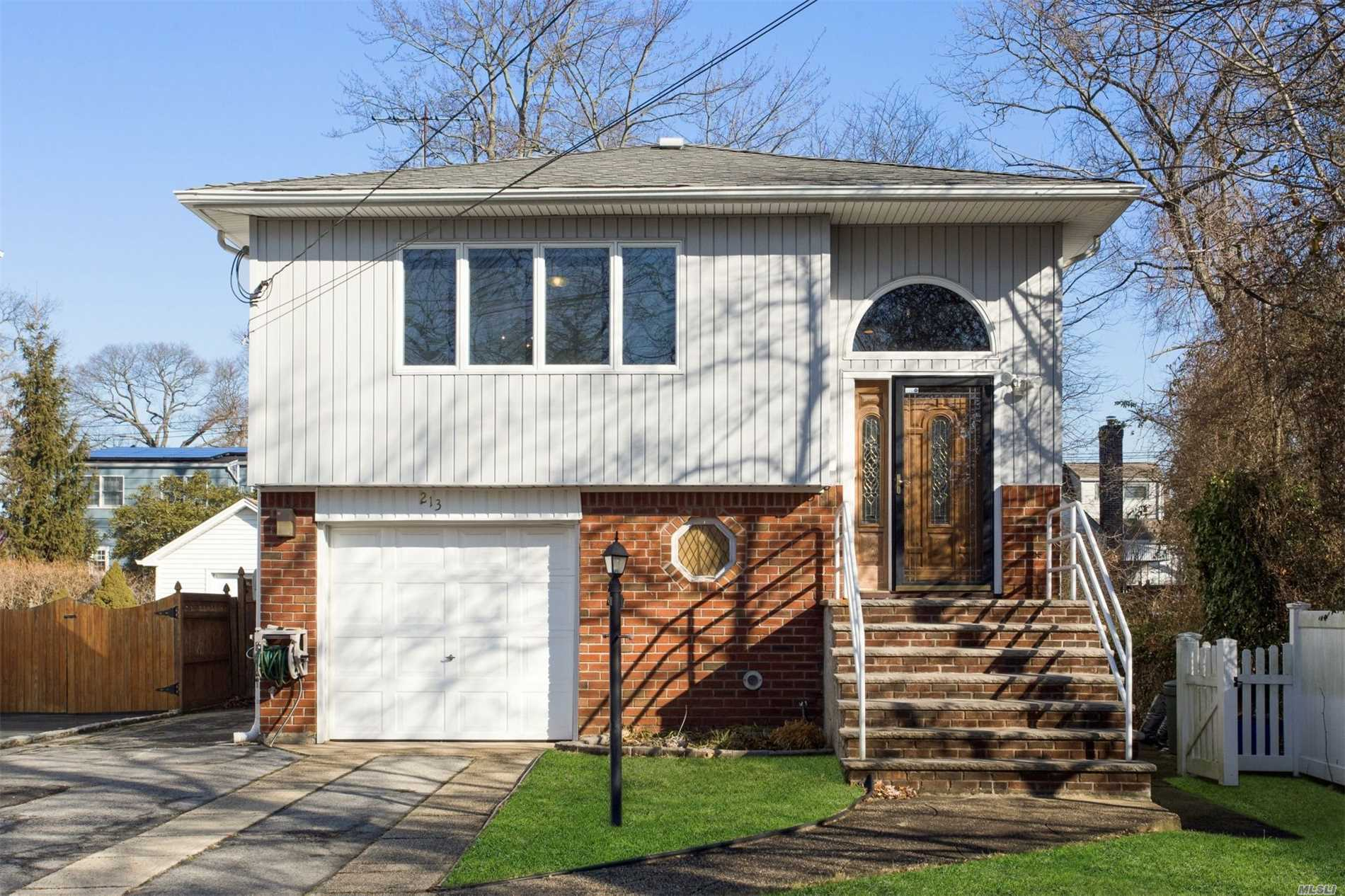 Desirable Location, Spacious Home, Comfortable Living Spaces! Situated In Valley Stream's Westwood Section, Blocks From The Lirr And Firemen's Field, This Home Is On A Peaceful Cut-De-Sac. Renovated Bathrooms And Kitchen, Family Room, Central Air Conditioning And More!