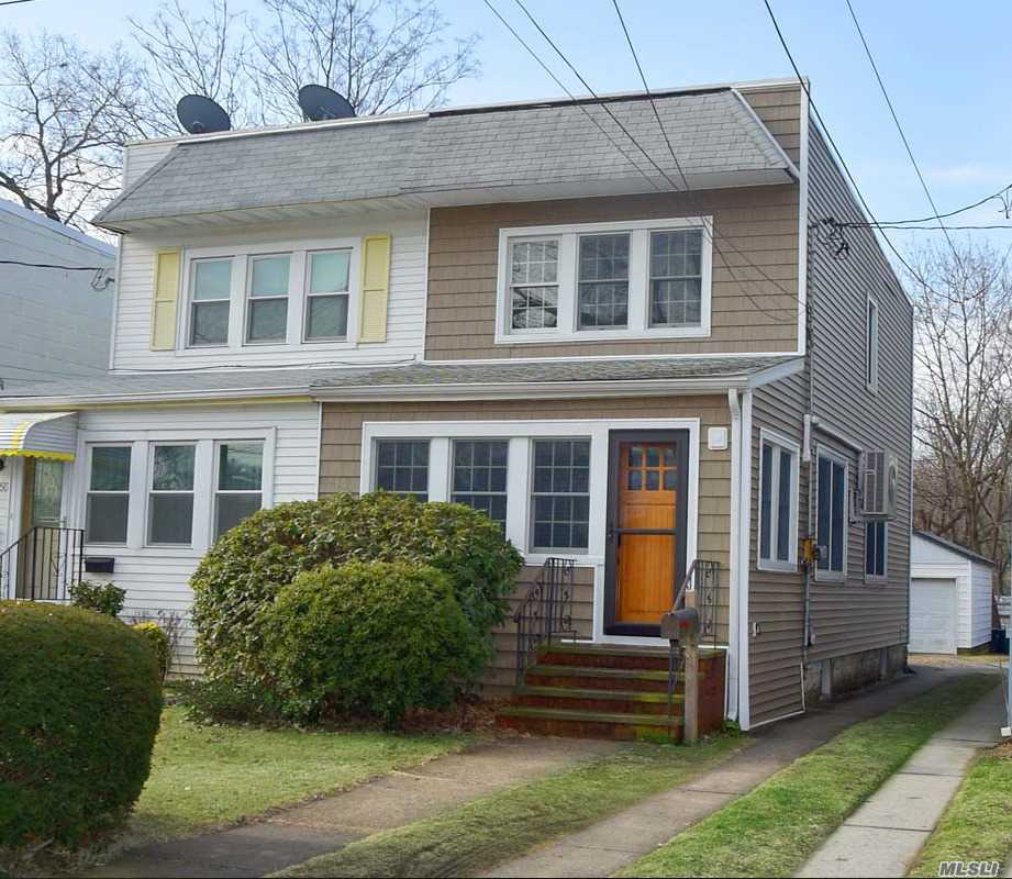 Magnificent Charming Colonial Located In Desirable Little Neck! This Completely Updated Home Features E.I.K., Stainless Steel Appliances, Hardwood Floors, Formal Dining Room, And Office. 3 Large Bedrooms And Full Bath On Second Floor. Finished Basement With Gas Heat And Stand Alone Garage. Perfect Location For Lirr, Bus, Parkways And Northern Boulevard.