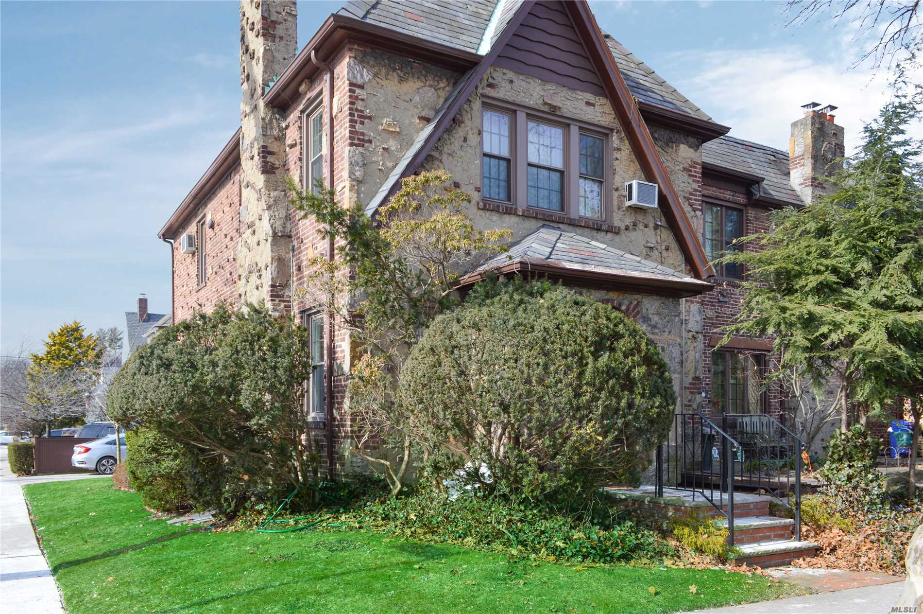 Corner Solidly Contructed Of Brick & Stone Semi-Detached Beautiful English Tudor In Bowne Park Area Of Flushing North, With Spacious And Airy Layout, High Ceilings, Original Preserved Wood Floors, Fireplace (Behind Wall), Skylight, Covered Wood Deck, Conveniently Located Near Transportation (Q16, Lirr-Broadway Station) Schools (Ps 32 Is 25) Shopping And Park. Ideal For Buyers Looking For A House With Character And Great Bones, Ready To Add Own Personal Touches To It.