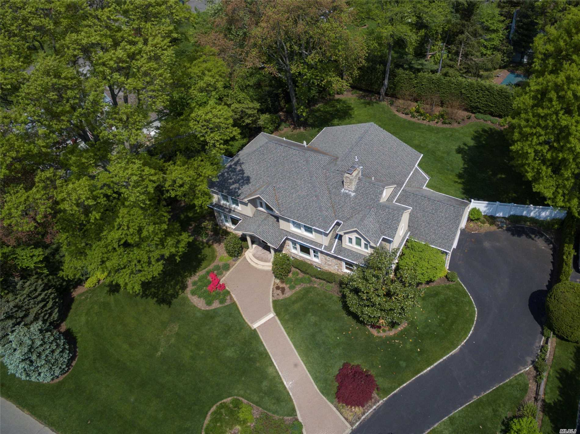 This Flower Hill Colonial Has It All! Totally Rebuilt & Renovated In 2003. Magnificent Property Large Enough For In-Ground Pool. Designer Kitchen With High End Appliances And Large Eating Area. Banquet Sized Dining Room. Family Room With Fireplace. Enormous Master Bedroom Suite, Surround Sound Through Out And So Much More! Generac Generator.