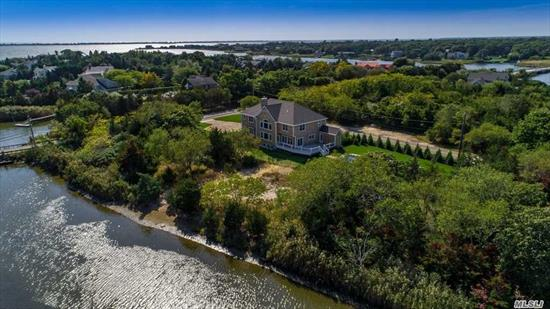 Open Floor Plan In This 4237 Sq. Ft. Mansion. Cathedral Ceilings Galore. The Backyard And Rear Of Estate Has Commanding Views Of Where Creek Meets Moriches Bay. All 4 Bedrooms Have Private Full Bathrooms. The Salt Water Pool Has Its Own Pool House With All The Comforts. Pick Your Colors And Upgrades Now. The Large Kitchen Has Huge Island .There Is Ample Space In The Dining Room. The Floor Plan Is Great For Entertaining. Construction Is Scheduled For Summer 2019 Completion.