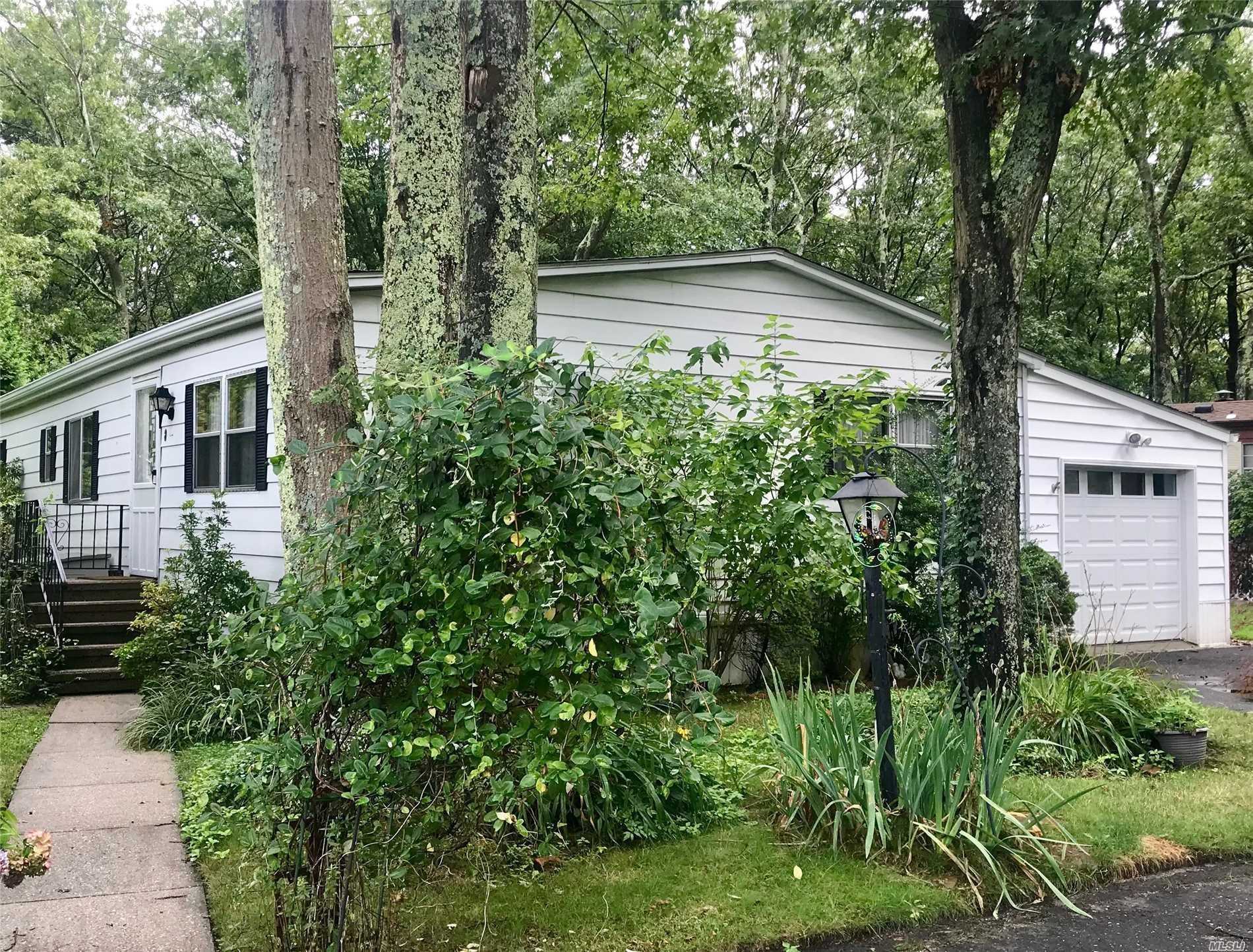55 And Over Community. Cash Only. Beautifully Maintained Double Wide. Large Kitchen, Formal Dining Room, Family Room, Two Bedrooms, Two Full Baths. Owners Put In A Beautiful Art Studio, With Air-Conditioning And Heat. Can Be Changed To A Sun Room Or Garage. New Roof. New Skylights. Tons Of Privacy, On The Preserve. Monthly Land Rent $979.82 Includes Taxes, Water, Trash, Snow Removal, Cesspool Maintenance And Use Of Clubhouse. Access To Southampton Town Beaches With Residence Permit.