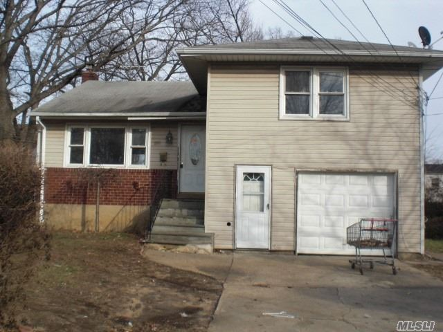 Garage Converted To Living Space, Hardwood Floors, Will Require A Total Overhaul!