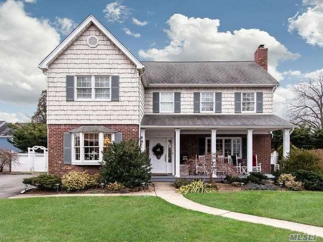 A Custom 4 Bedroom Center Hall Colonial In The Carle Place School District Featuring Front Porch Large Living Room With A Wood Burning Fireplace, Large Kitchen, Formal Dining Room, 4 Good Size Bedrooms All Upstairs Plus Bath, Finished Basement With High Hats & Carpet-A Must See !!!