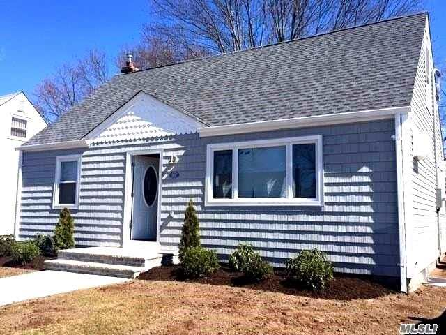 Total Gut Renovation, Wood Fl., New White Shaker Kit. Cabinets, W Stone Counter Top, Dish Washer, Stainless Appliances, Open Floor Plan, 2 Full Baths With New Tile, Full Finished Basement With Heat, Washer/Dryer Rm. Tile Floor, New Boiler And Hw Heater, New Doors, New Roof And Siding, New Windows,  Spacious Back Yard, ---Turnkey.