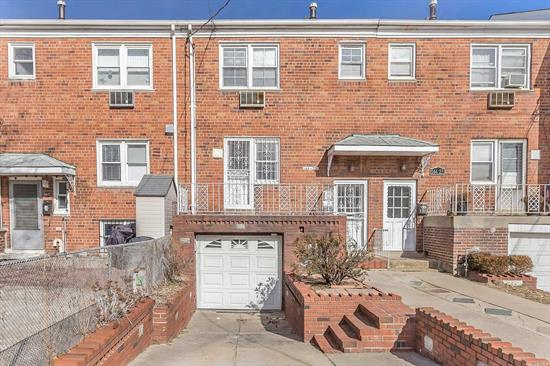 Excellent Income Producing All Brick Two Family Property In Great Location Of Flushing! 3 Bedroom Duplex Over Studio With Beautiful Backyard Garden, Private Driveway And Garage, Washer Dryer And Updated Kitchens. A Must See!