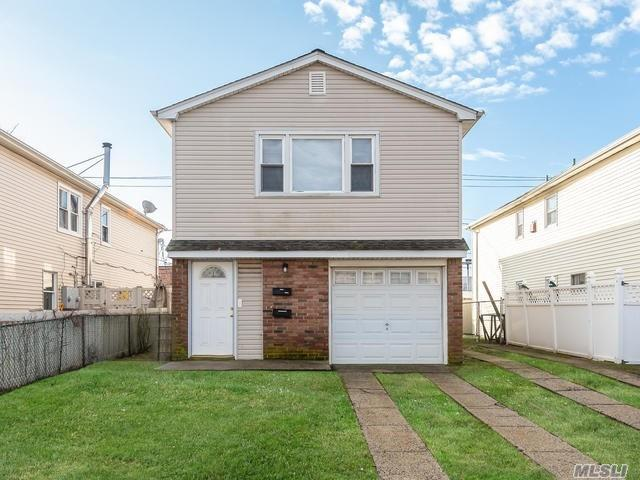 Beautifully Maintained, Legal Two Family (3 Bedrooms Over 2 Bedrooms). Updated Baths. Nice Mid Island Location. Near To Shopping. Blocks To Ocean.