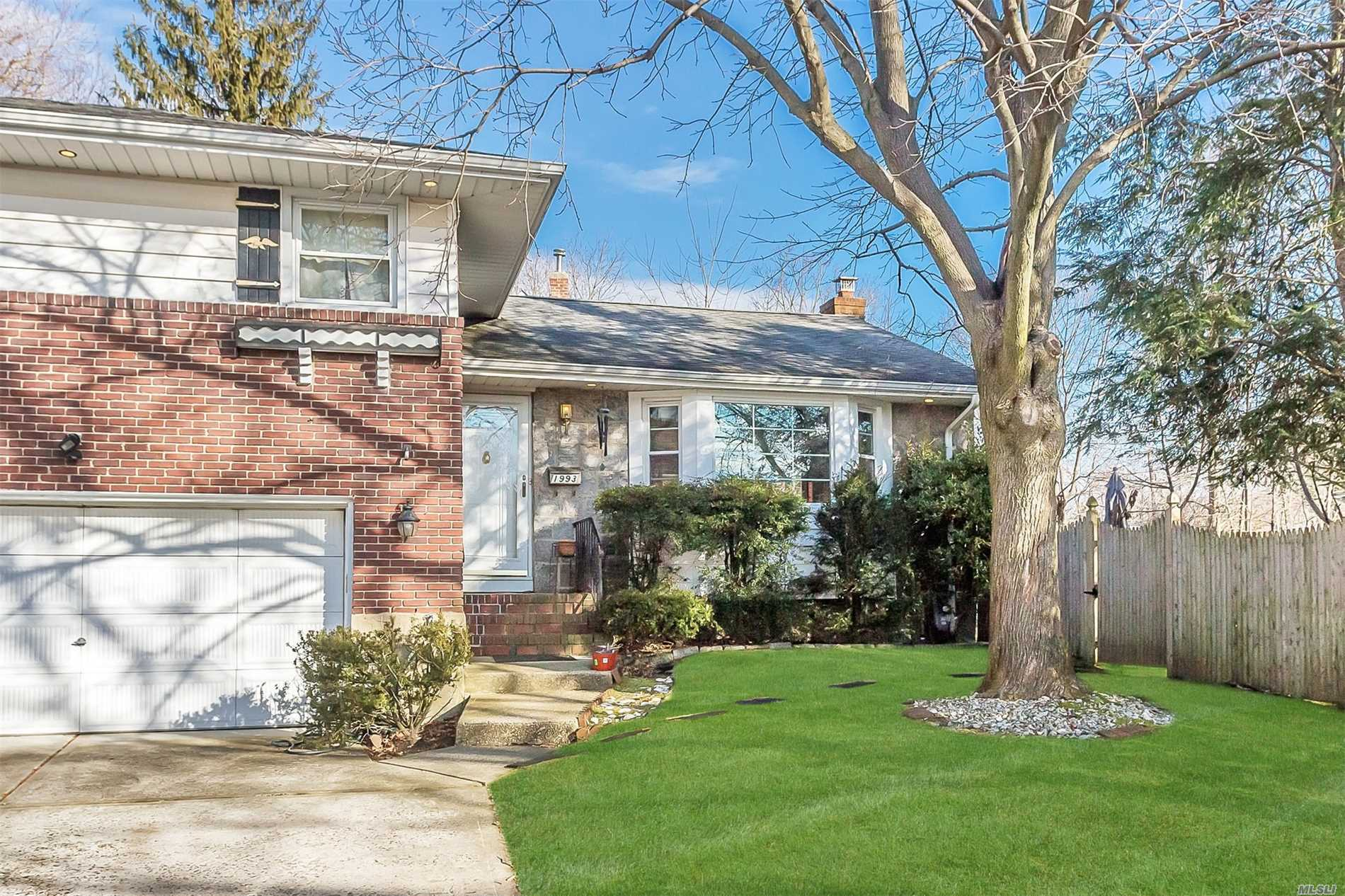 Beautiful 4 Level 3 Bdrm 2 1/2 Bath Merrick Manor Split On A Cul-De-Sac On Private, Park-Like Grounds! Eik, Living Rm W/Gas Fireplace, Fdr, Hardwood Floors, Den W/1/2 Bath, Finished Basement. Updates Include: 2013 Gas Heating System, Hw Heater, 200 Amp Electric, 2016 Cac Compressor, 2008 Updated Bathrooms, Windows In Living And Dining Rm. Won't Last!