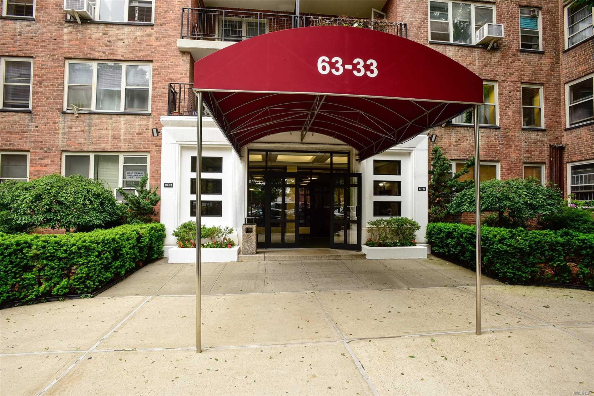 Spacious 1 Bedroom Doorman Building With Parking Space Included. Features Windows In Every Room, Plenty Of Closet Space. Prime Location In Rego Park, Walking Distance To M & R Train, Supermarkets, & Restaurants. Laundry In Basement. Lots Of Potential!!!