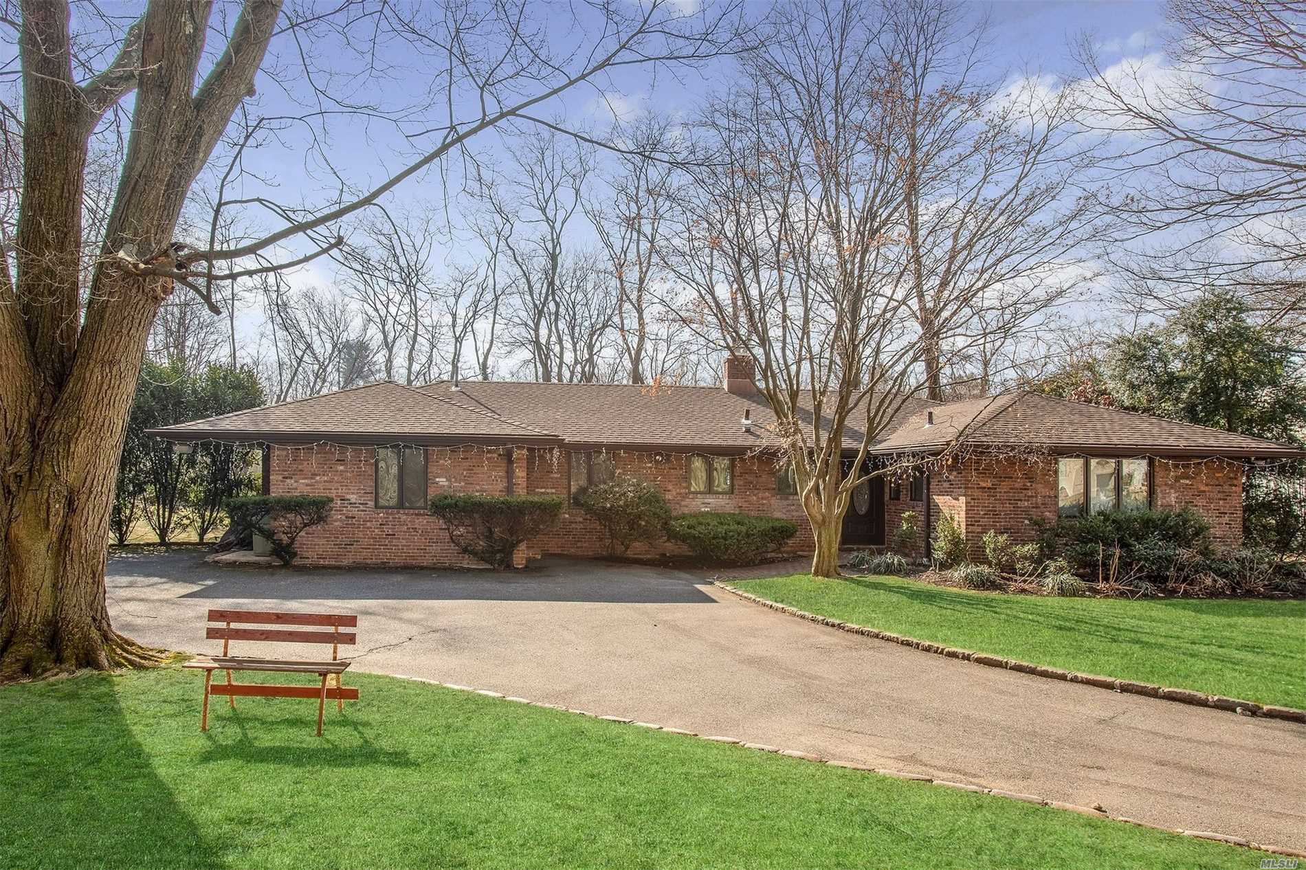 Beautifully Renovated Expanded Ranch Set On .569 Acre Of Professionally Landscaped Property Located Within A Private Cul De Sac. Inviting Living Room With Expansive Yard Views. Formal Dining Room, Gourmet Eat-In-Kitchen, Large Master En Suite, Three Additional Bedrooms, Great Closet Space Throughout.New Roof, 8 Surveillance Cameras, Full Lower Level.