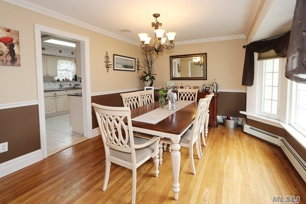 Welcome Home To This Beautiful Sun Drenched Colonial Situated On A Flat-Perfect Quarter Acre In The Award Winning Commack School District. The Perfect Atmosphere For Daily Living, Featuring Huge Master Suite, Generous Sized Bedrooms, Gleaming Hardwood Floors Throughout. Updates Galore Including Siding, Roof, Half Bath & More