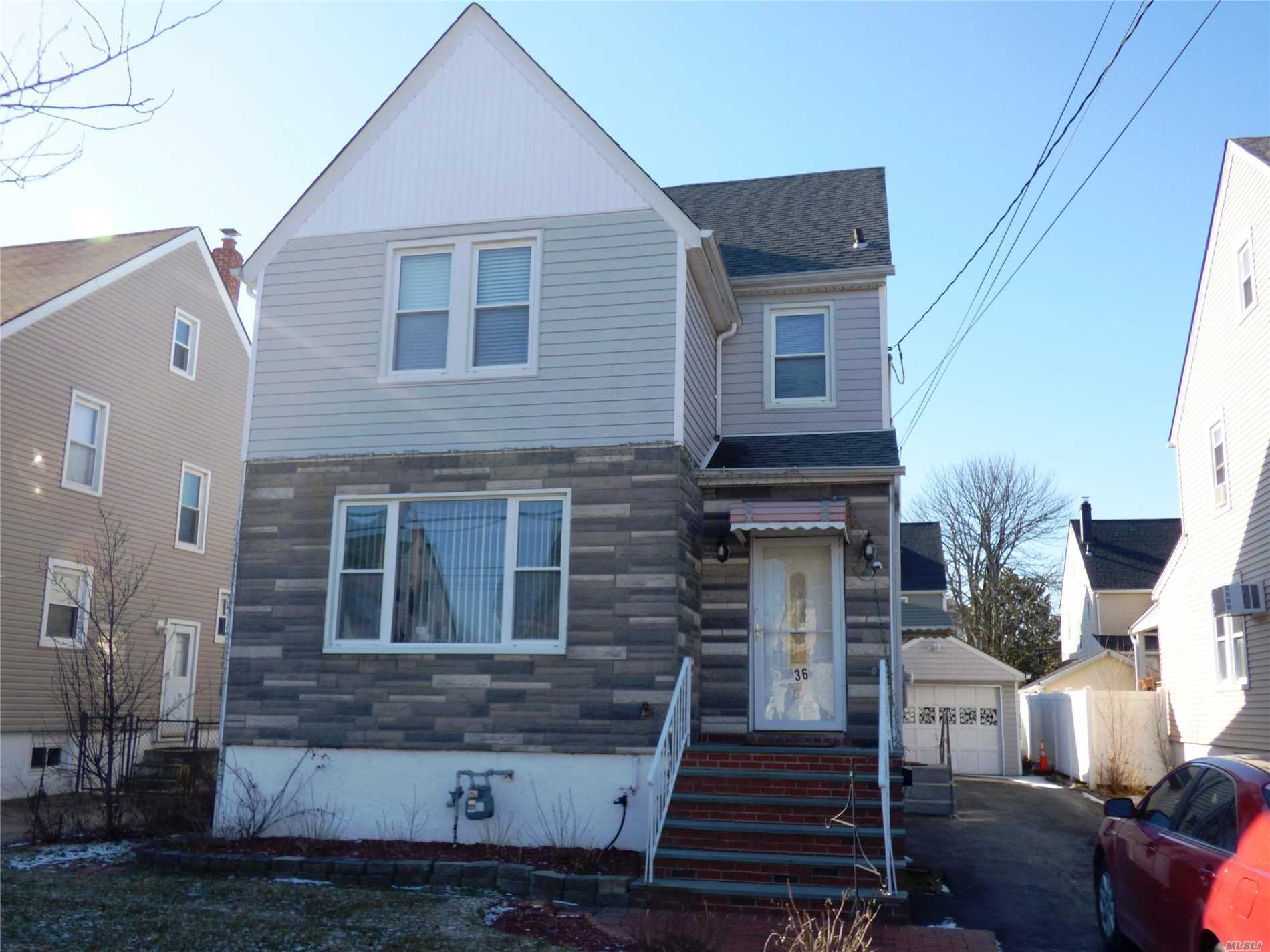 Spacious And Bright 1st Floor 2 Br Apartment With Full Finished Basement. 1st Floor Mbr, Br, Eik, Lr, Office/Den, Full Bath. Beautiful Hardwood Floors. Finished Basement W. Tile Floor, Large Family Room And Bonus Room And Second Full Bath. Access To Backyard. Two Driveway Parking Spaces.