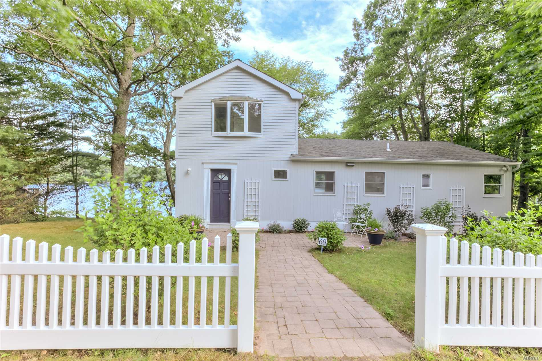 Located In The Desirable Little Fresh Pond Community This Fully Renovated Beach House Is Ready For Your Hampton's Experience. Situated On .16 Acre This Newly Renovated Waterfront Offers 3 Bedrooms, 2.5 Baths, New Hardwood Floors, Central Air, Open Floor Plan With The Chef's Kitchen Adjacent To French Sliders Overlooking Little Fresh Pond. Soak In The Sun On The Expansive Deck Perfect For Morning Sunrise Or Romantic Sunsets And Experience The Serenity Of This Beach House Design. Minutes To Ocean!