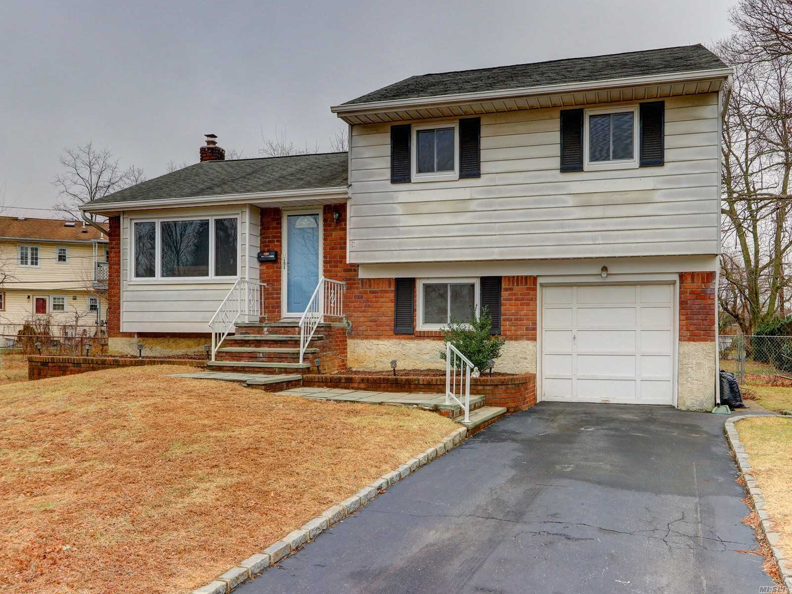 Spacious 3 Bedroom Split Hardwood Floors Thru-Out, Hugh Basement Unfinished With W/D Gas, Updated Gas Heat, 2 Year Old H/W Heater Park Size Fenced In Yard & Covered Patio