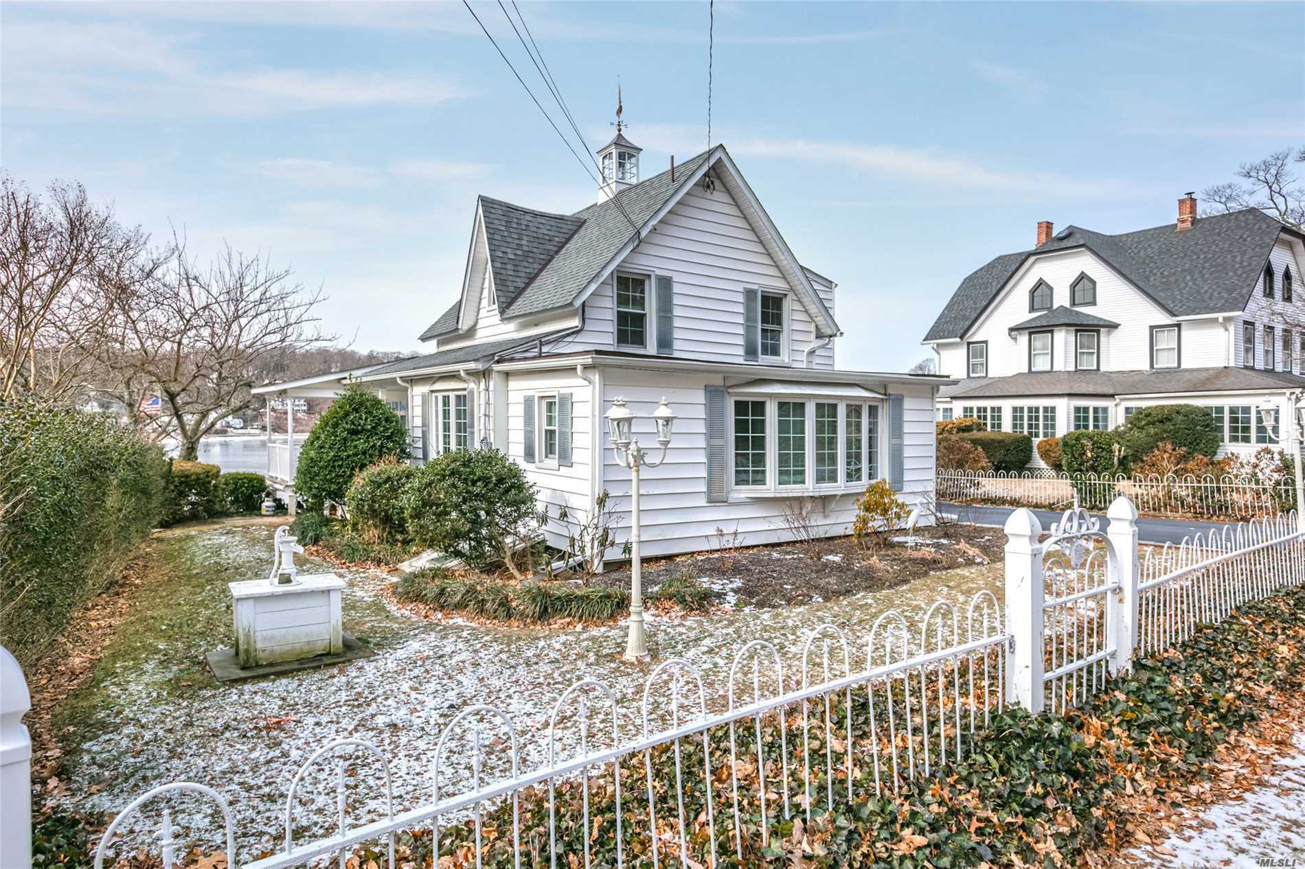 Waterfront. 58' Bulkhead. Charming Circa 1860 Sea Captains House. Panoramic Waterviews Of Centerport Harbor And Mill Dam Bridge. Relax & Enjoy Breathtaking Sunsets. Entry, Parlor With Bow Window, Full Bath, Formal Dining Room, Living Room, Kitchen, Office/Play Rm, 3 Season Sunroom (28'X10.5'). Trex Decking Off Dining Rm. 2 Bedrooms, Sitting Room, Full Bath. Walkout Lower Level, Recroom/Bar, Wood Stove, Half Bth. Updates: Windows, Roof, Gas Boiler/Hw Heater, 200 Amp Electric And Gas Generator.
