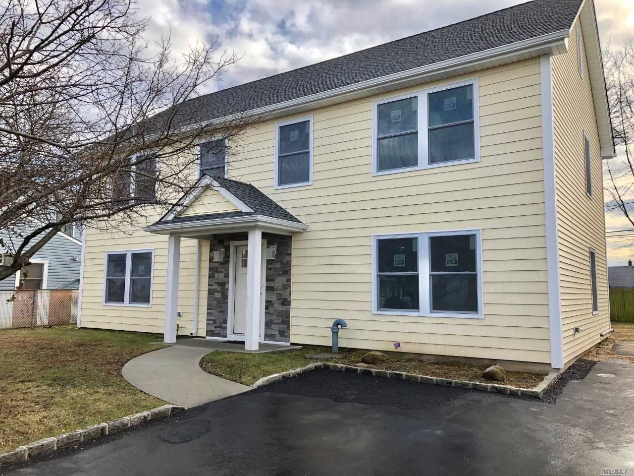 Bright & Stunning New Construction. 2600 Sf Colonial W/ 5 Br & 3.5 Ba, 8' Ceilings, Eik W/ Quartz & Samsung Ss Appliances, Spacious Living Rm, Fdr, Porcelain Tile, Hw Floors (Stain To Choice), Master Suite 2nd Fl Plus Br Suite On 1st Fl, Oversized Andersen Windows Throughout, 95% Energy Effic. Navien Combi-Boiler System, 5 Ton Rheem Cac, Life Gaf Archit. Roof, Low Taxes, Town Approval For Garage, Massive Attic Space, Buyer Finish 4 Up Br Floors To Taste. Many Options & Exceptional Top To Bottom.