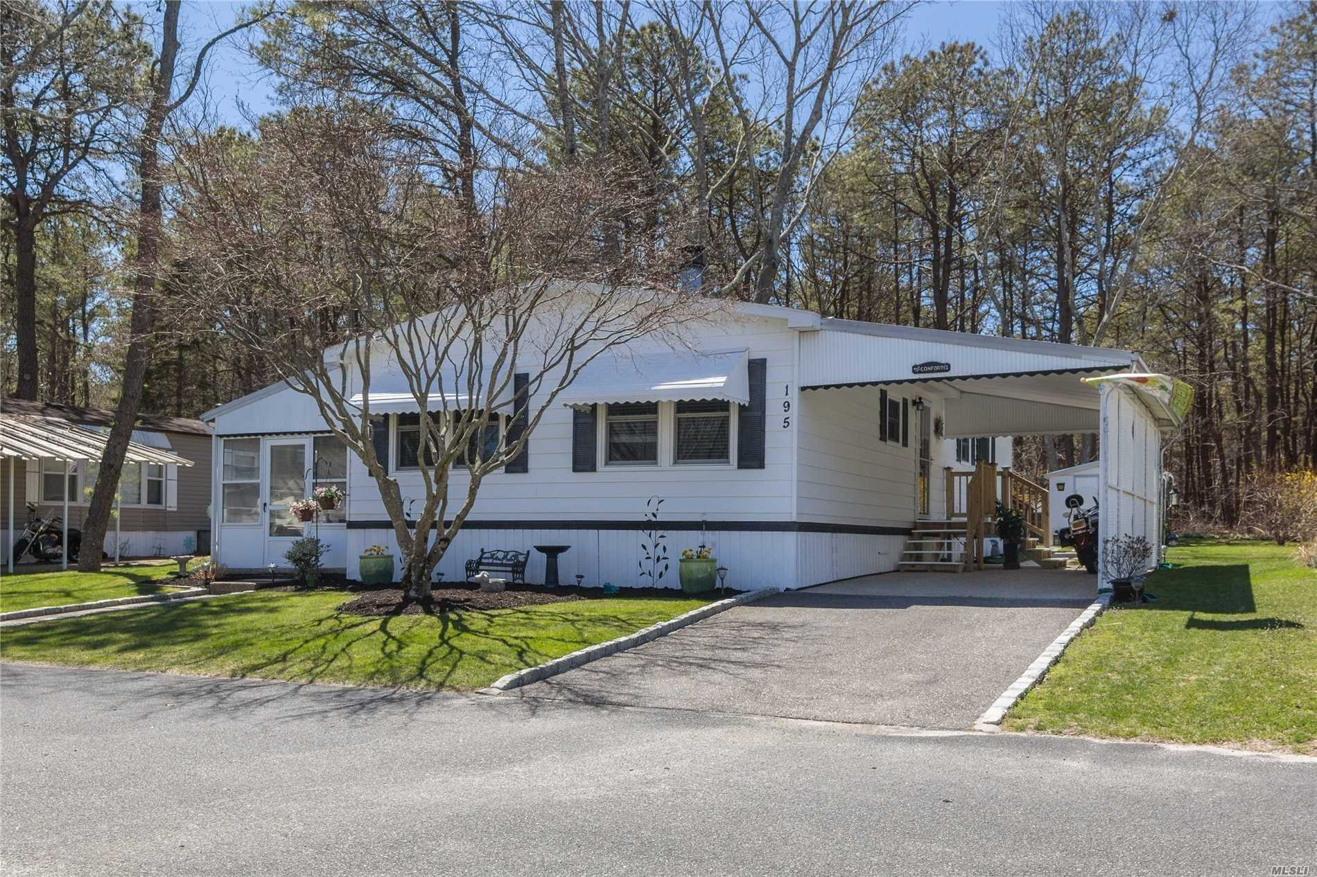 55 And Older Community., Cash Only. Doublewide On Preserve. Kitchen And Bathroom Have Been Updated. Newer Wooden Flooring. New Appliances. Belgian Block Driveway. 2 Bedrooms Both With Walk In Closets. 2 Full Baths One With Tub. Sunroom. Deck Overlooking The Preserve. Rare Find! Unit Has Wood Burning Fireplace. Land Rent Is $919.68 Per Month. Includes Trash And Snow Removal. Water, Cesspool Maintenance. Use Of Clubhouse With Gym. Southampton Tax And Beach Rights. New Roof! 2 Sheds!