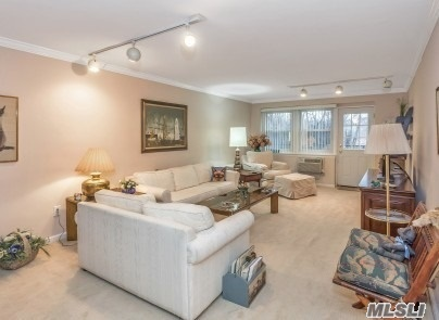 Extraordinarily Large And Sunny Two Bedroom Unit In Pristine Condition. Totally Updated Kitchen And Baths. Terrace Overlooks Pool And Entry. Large Master With Walk In Closet And Bath. Fully Carpeted. Plenty Of Closets Throughout. Close To Shopping, Lirr And Bus Transportation. Glen Cove Offers Beaches And A Public Golf Course. Move Right In!