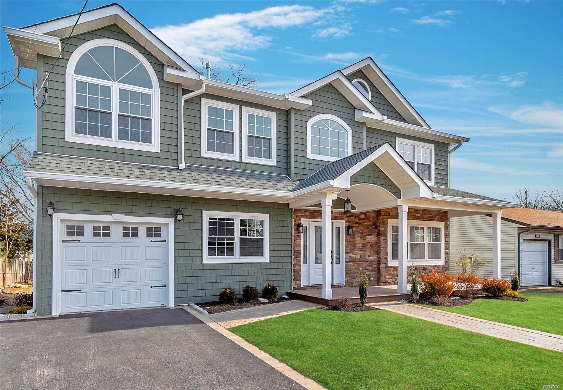 This Custom Residence Is Designed With Hardwood Floors Throughout, An Open Kitchen Plan. Master And 3 Bedrooms On Second Floor And One Bedroom On Main Level Makes This Easy Living. Ceilings And Windowed Walls Fill The Home With Natural Light. Magnificent Grand Foyer With Chandelier Lift Kit. Other Features Includes Central Air Condition, Hot Air Heating, Laundry On The First Floor.