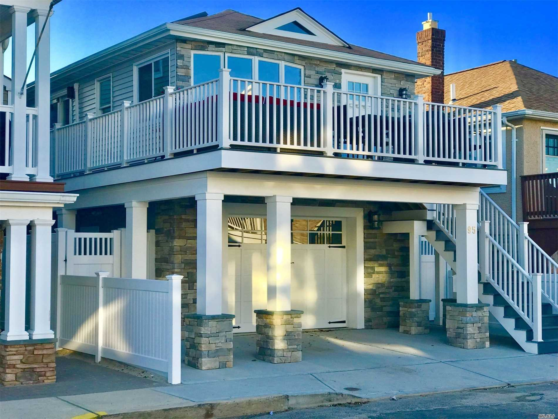 Stunning Contemporary Raised Ranch On Wide Block. Like New/Totally Renovated Inside&Out Beach House. Offering Top Of The Line Features Thru-Out. Impressive Grand Room Design With Vaulted Ceiling And Fireplace, Designer Kitchen & Bathroom. Fema Compliant Home W/Full First Level Garage Accommodating 4 Cars & Storage. Potential For 2nd Bedroom.