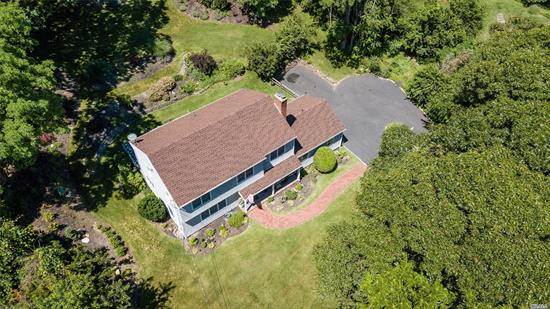 In a Pvt Beach community Sits This Custom Colonial on a quiet street.Nearly An Acre Of Land, Beautifully Landscaped. 23 Zone In Ground Sprinklers. 2 Master Sized Br Suites W Pvt Baths, 2 Additional Bedrooms, Fdr, Den W Working Fireplace, Custom Kitchen Cabinets w Granite Counter Tops. Partial Winter water Views, Pvt Beach Rights And So Much More!