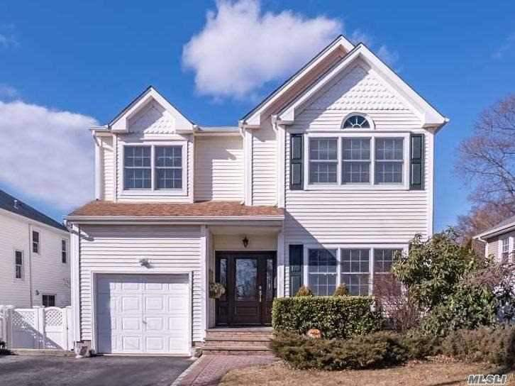 Beautiful Colonial With Great Attention To Detail! Custom Moldings, Archways & 9' Ceilings Throughout. Ef, Formal Living Rm, Formal Dining Rm, Eik, Family Rm W/River Stone Fpl & Sliders To Yard, Washer/Dryer & Half Bath. 2nd Floor: Mstr Ste W/Vaulted Ceilings, Walk In Closets, Bath W/Jacuzzi Tub & Shower, 3 Addl Lge Bdrms, Center Hall Full Bath. Full Finished Basement. Backyard Oasis With Deck & In-Ground Pool Surrounded By Perennial Garden. A Must See!