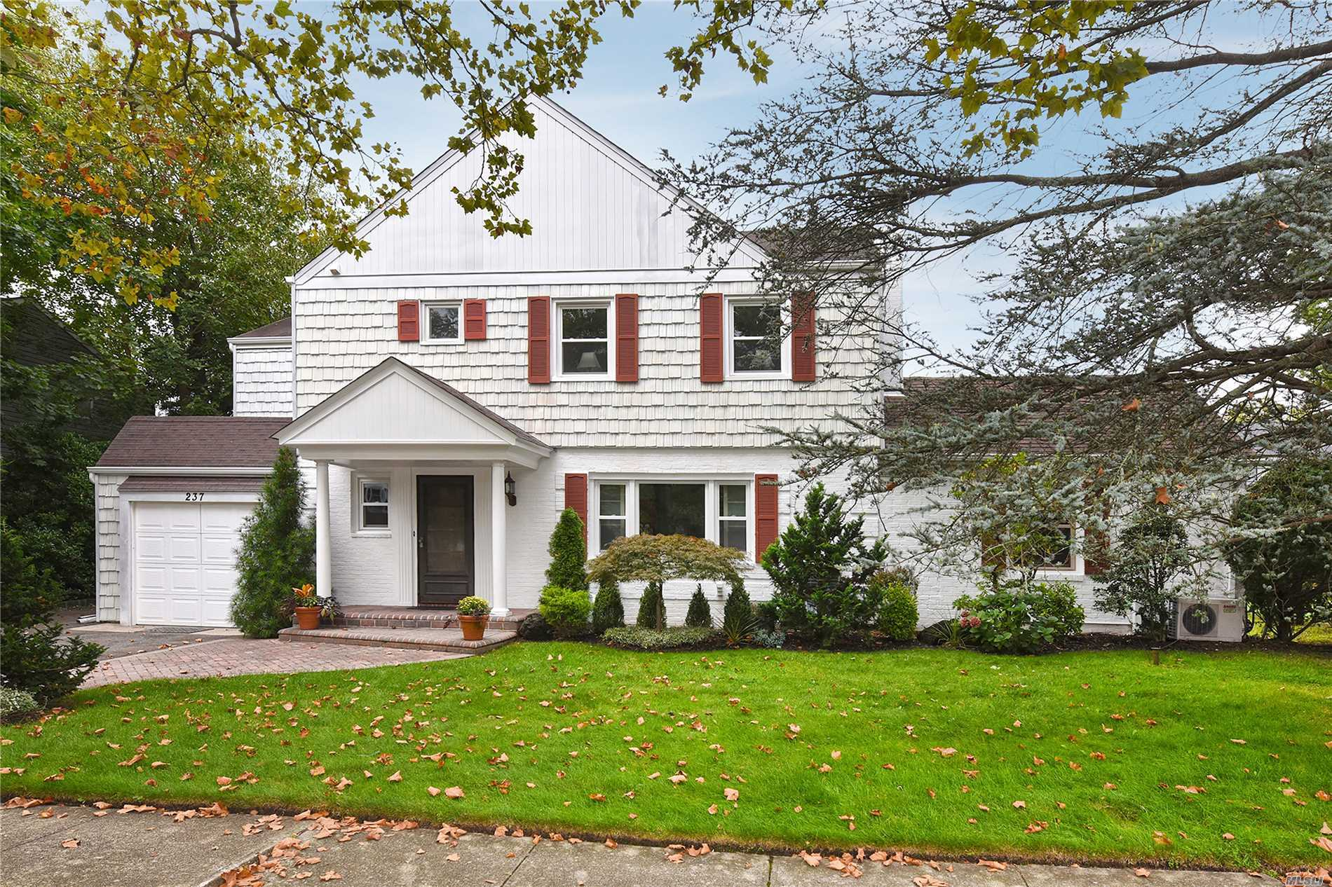 Warm & Welcoming 5 Br, 2.5 Bth Expanded Side Hall Colonial In Sd#20 (Lynbrook).Sunlit Updtd Gran/Wood Eik W/ Garden View, Huge Family Rm W/ Fpl, Enclosed Sun Room W/ Walls Of Windows & Access From Den & Garden. Finished Bsmt Has Wet Bar. Att Gar W/ Built In Storage Cabinets. Pull Down Attic Has 8 ' Ceiling In Center & Cedar Closet. Hw Floors & Crown Moldings.Spacious Yard In Quiet Neighborhood. No Sandy Damage. No Flood Insurance Required. Tax Grievance Submitted For 20/21
