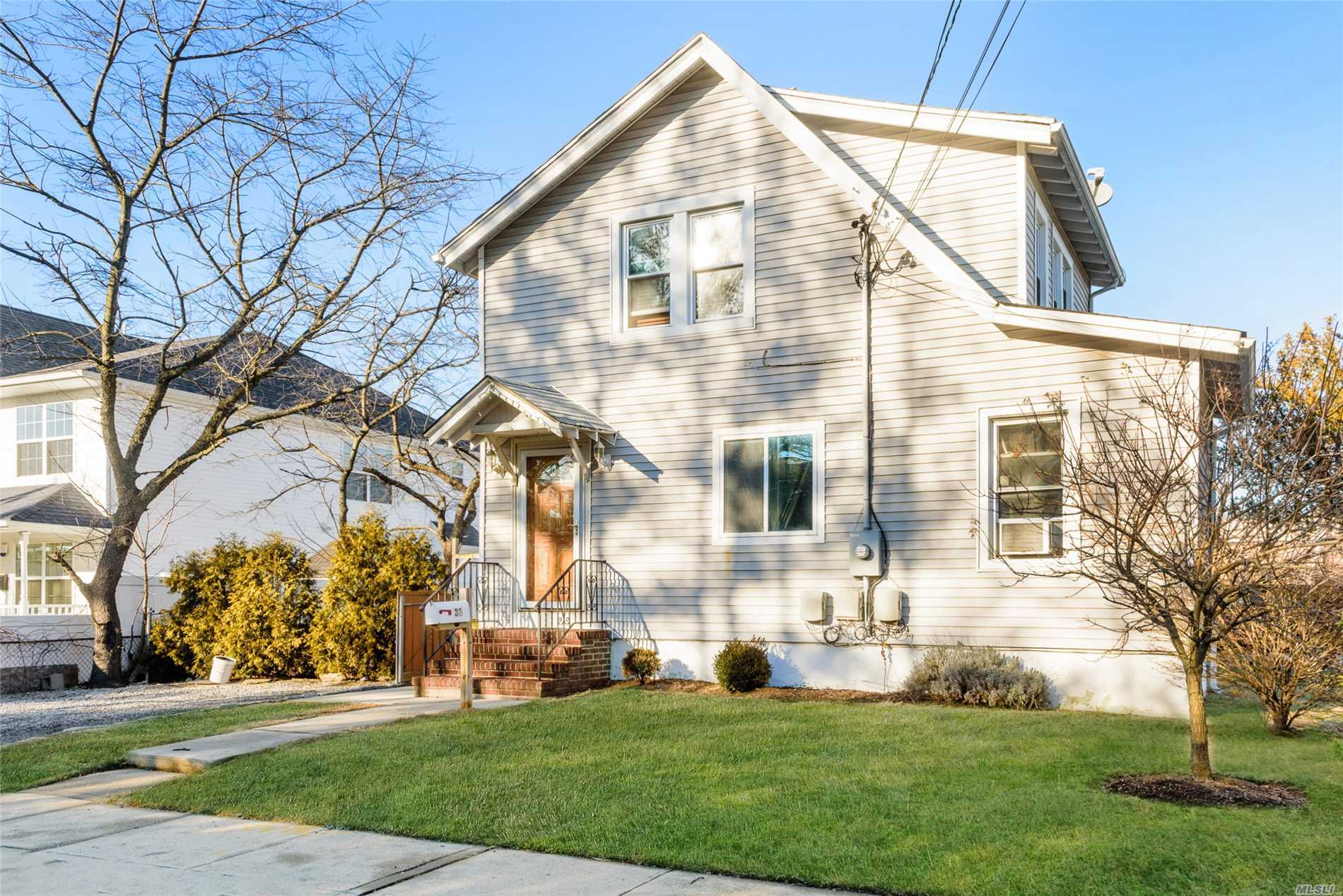 Corner Property Single Family Home Features 2 Bed 2 Bath With Partial Basement. Situated In A Prime Location With A Tremendous Garage!