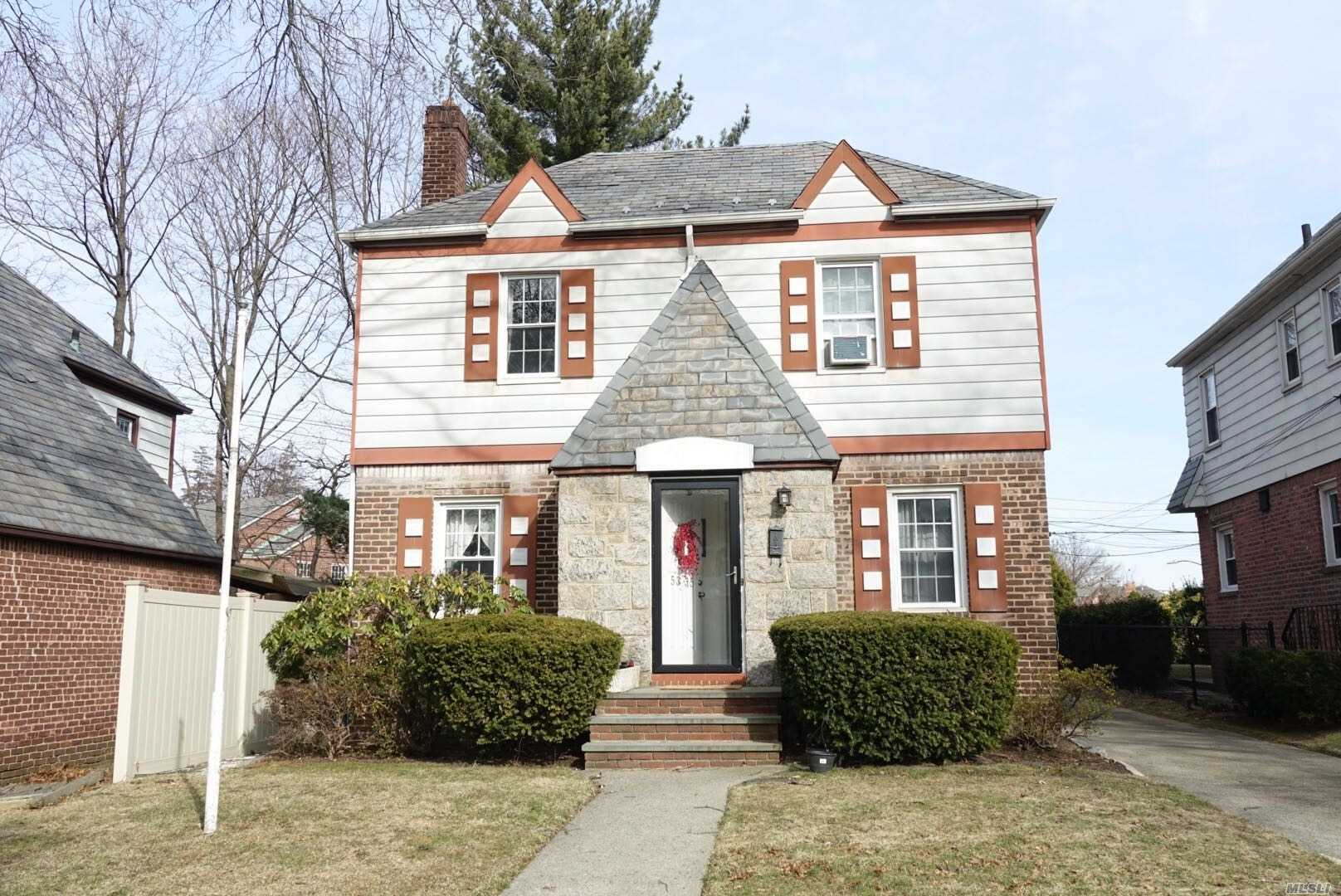 This Beautiful Colonial In Bayside Hills Features 3 Lovely Bedrooms, 1.5 Full Baths And A Full Finished Basement.Move In Condition, New Kit And Bath Room, New Wood Floor, 1 Car Garage. Close To Major Highway, Walking Distance To Ps 203 Ms74. And Cardozo Hs. Close To Bus Q27, Q31, Q30 To All.