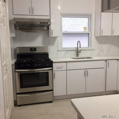 Newly Renovated Extra Large 3 Bedrooms And 2 Full Baths Apartment In The Heart Of Bayside. Large Living Room, Formal Dining Room, Updated Eat-In-Kitchen, Nice Hardwood Floor, Washer And Dryer In The Unit, Parking Is Included. Best School District (Ps203, Is74, Cardozo High School), Must See.