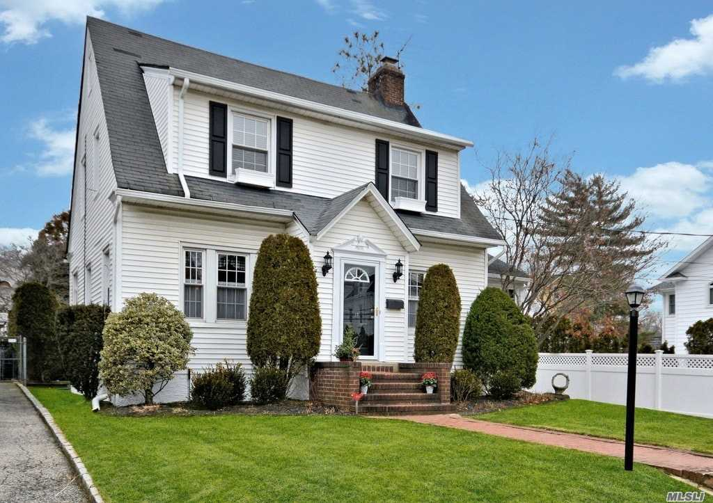Classic 4Br/2.5Bath Colonial Located In The Desirable Harvard Section Of The Village. Entry Foyer Leads To Large Living Rm W/Fireplace , Office, Formal Dining Rm, Stainless/Granite Kitchen, Family Rm & Dining Area That Leads To A Large Deck & Landscaped Yard With 2 Car Garage. Home Has Great Flow For Entertaining .Master Suite With Full Bath & Walk In Closet , 3 Addt'l Bedrooms, Attic For Storage.Basement Part Finished With Laundry And Utilities Convenient To All . A Must See!