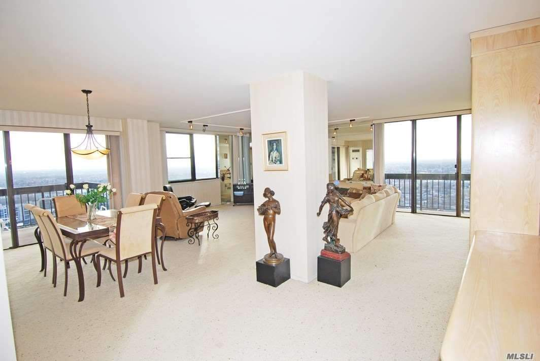 Sunny Southeast Exposure With Panoramic Unobstructed Golf, Pool And South Shore Views! Fully Equipped Eik With Washer /Dryer And Windowed Dinette. Huge Wide Open Entertainment Area With Fdr And Large Lr. Incredible Lush Views Overlooking The Golf Course From Your Large Walk-Out Terrace And Two Balconies. Lovely Wood Parquet Floors Throughout. Second Br, Guest Room / Den Has Floor To Ceiling Sliding Glass Doors With Balcony And Private Bathroom With Stall Shower. Oversized Mbr.