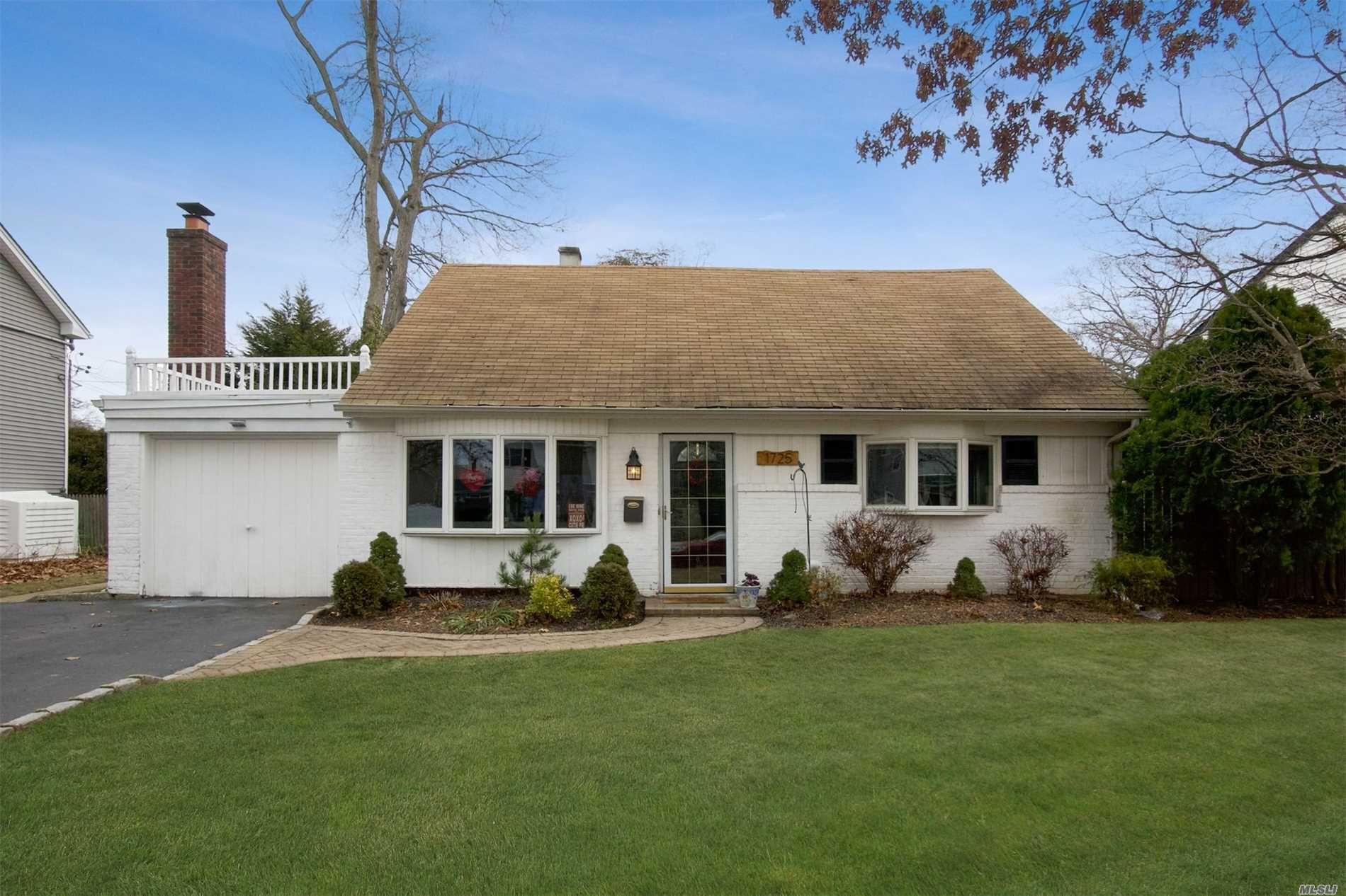 Wantagh Woods- Blue Ribbon School District-Super Low Taxes, Expanded Cape Located On A Tree Lined Block. Features Four Bedrooms, 2 Full Baths, Rear Dormer, Fireplace, Updated Heating, Kitchen, And Bathrooms. Extended Living Room & Extended Dining Room, Close To Rail. Taxes W Star Only $8585.86.