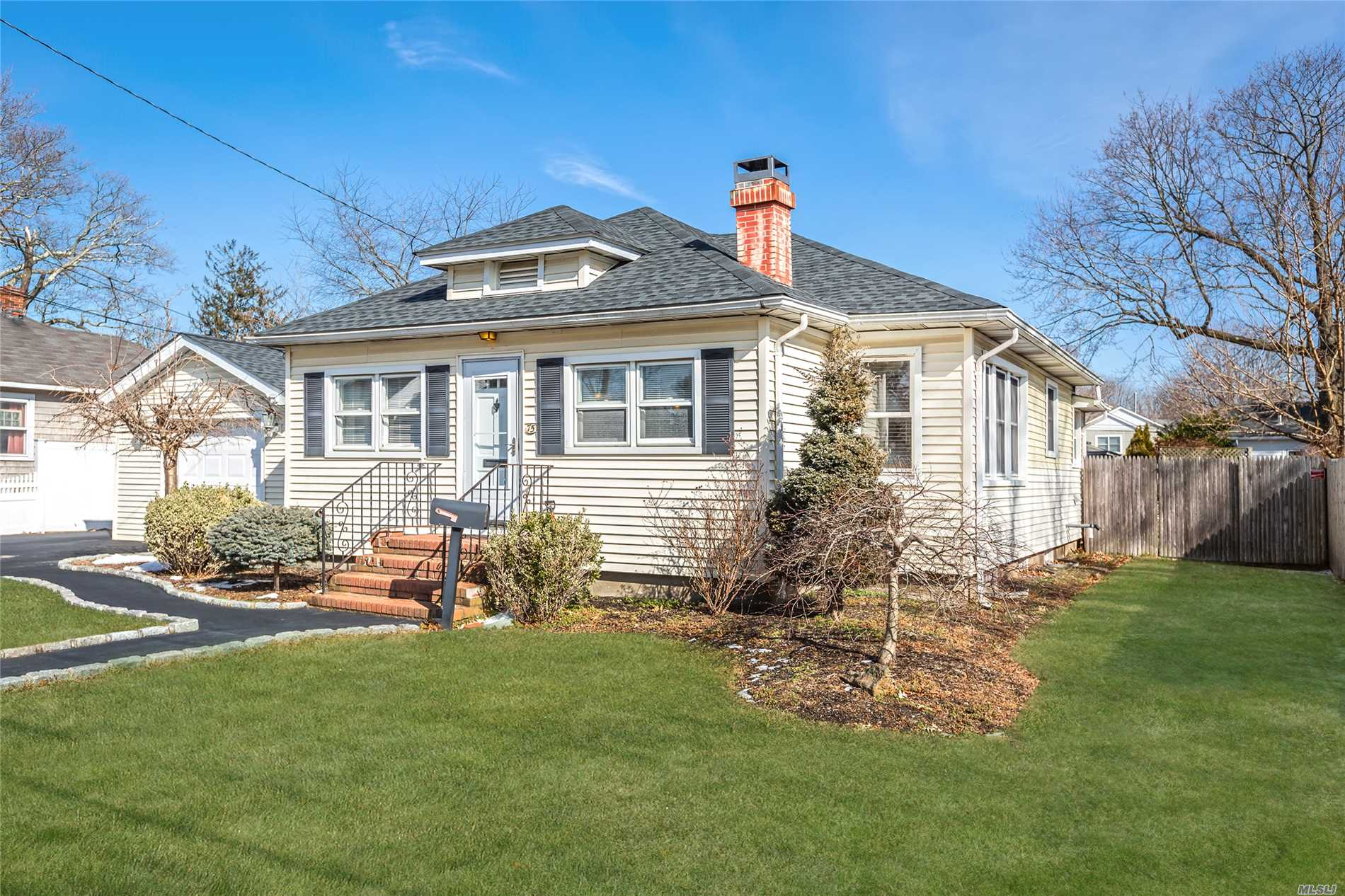 Move Right In To This Precious Ranch With Open Floor Plan. Beautiful Kitchen With Coffered Ceiling & Breakfast Bar Overlooking Nice Size Living Room. Detached Garage With Outsde Covered Bar....Ideal For Those Summer Gatherings. Full Basement, Wood Floors & Central Air Conditioning. Don't Miss!