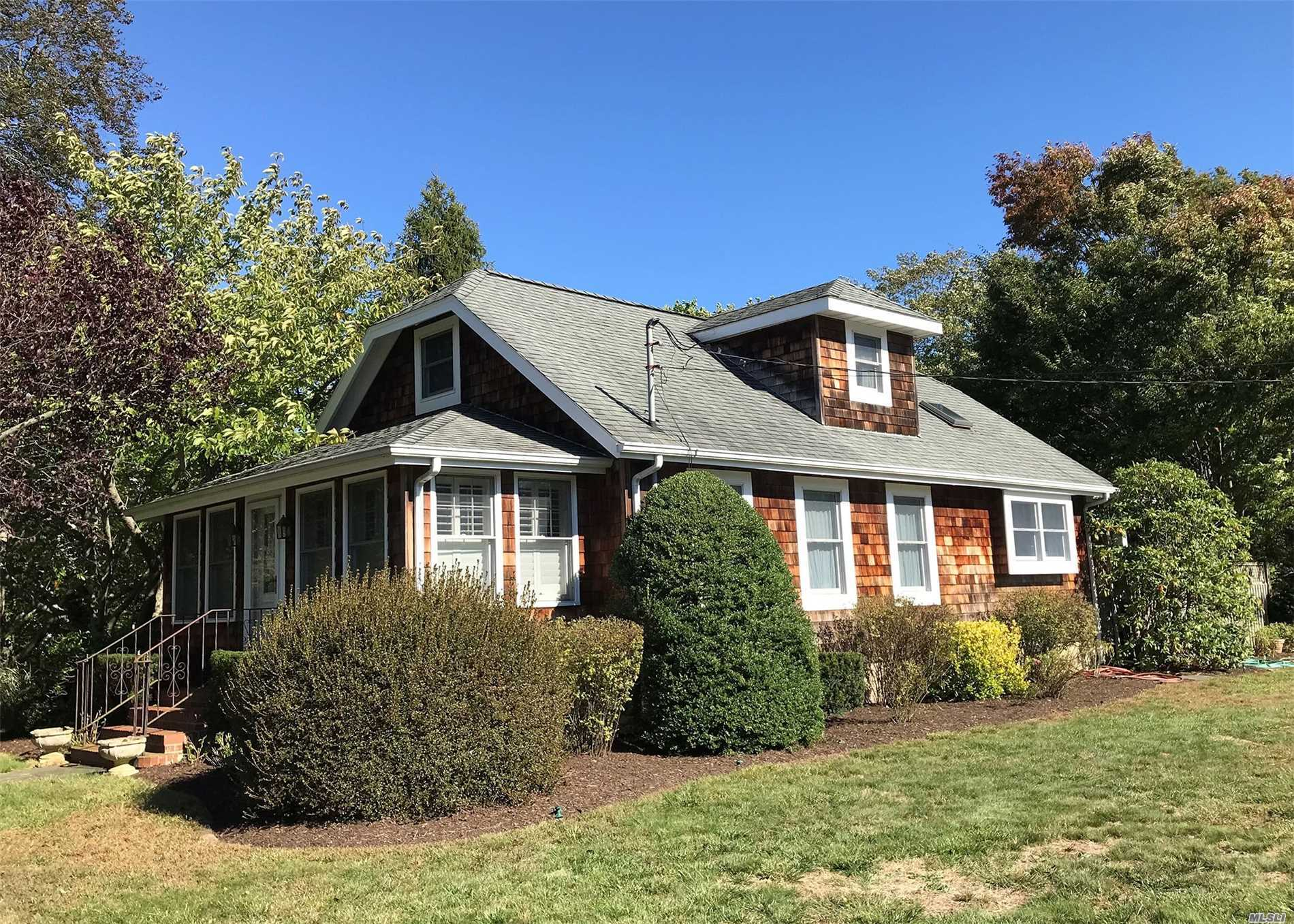 Charming Craftsman Style Cape With 3 Bedrooms And 3 Bathrooms Set On Beautifully Landscaped .62 Acre Property. This Thoughtfully Updated Home Is In A Prime Location, Close To Village Main St And Moriches Bay. The Home Also Features A 20 X 38 Detached Garage And Low Taxes.