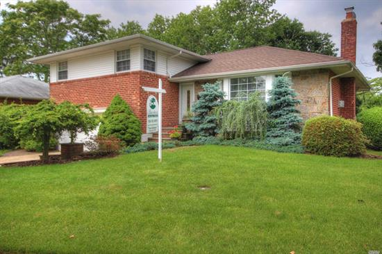 '' Please Note, Taxes Successfully Grieved & Are Being Reduced For Year 2019/2020 By 34.13% Brick Split In Move In Condition W/Mid Block Location, Features Open Floor Plan W/Updated Granite Eik, Living Room W/Gas Fire Place, Dining Room W/Access To Deck, Family Room, Master Bedroom With Full Bath, Wood Floors Thru-Out, Cac, Updated Windows, Newer Hot Water Heater, 4 Zone Igs, 2 Car Garage. Much More. !!!This Is A Very Nice House. Must See!!!