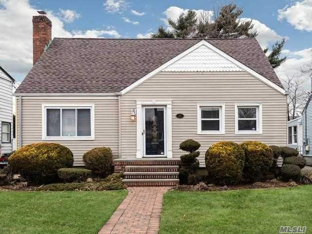 Mid-Block Dormered Cape W/ Dining Room Extension-French Doors To Deck & Yard. Gorgeous Cherry Wood & Ceramic Eik W/ Lots Of Working Counter Space. 2 Master Sized Bedrooms, Cac & In-Ground Sprinklers. Hi-Ceiling Beautifully Finished Play Room Basement.