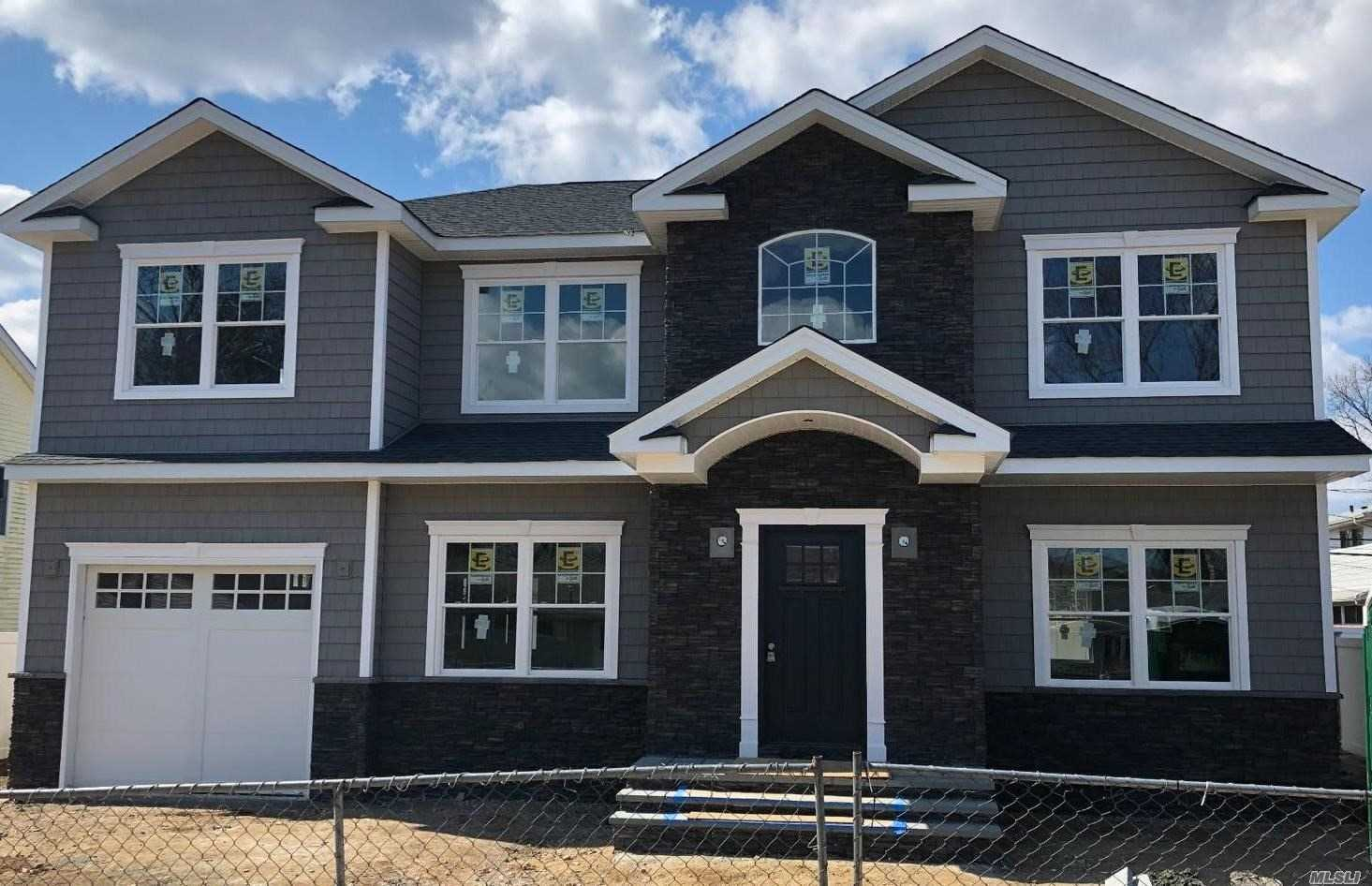 New Construction. Syosset Groves. Center Hall Colonial W/ 5 Bedrooms & 3 Full Baths. Quality Craftsmanship Throughout! Vaulted Entry, Custom Kitchen W/Granite Ci & Ss Appliances, Fdr W/Tray Ceiling, Fr W/Gas Fpl, Mstr Suite W/Bth & 2 Walk In Closets. 9' Ceiling On 1st Flr, 8' On 2nd & Bsmt. Gas Combi Heating Unit/2 Zone Hydronic Ha Heat/Cac, 200 Amp Elec., Prewired Cable/Cat 5E, Crown Moldings, Hi Hat Lighting, Alarm, Igs & More.