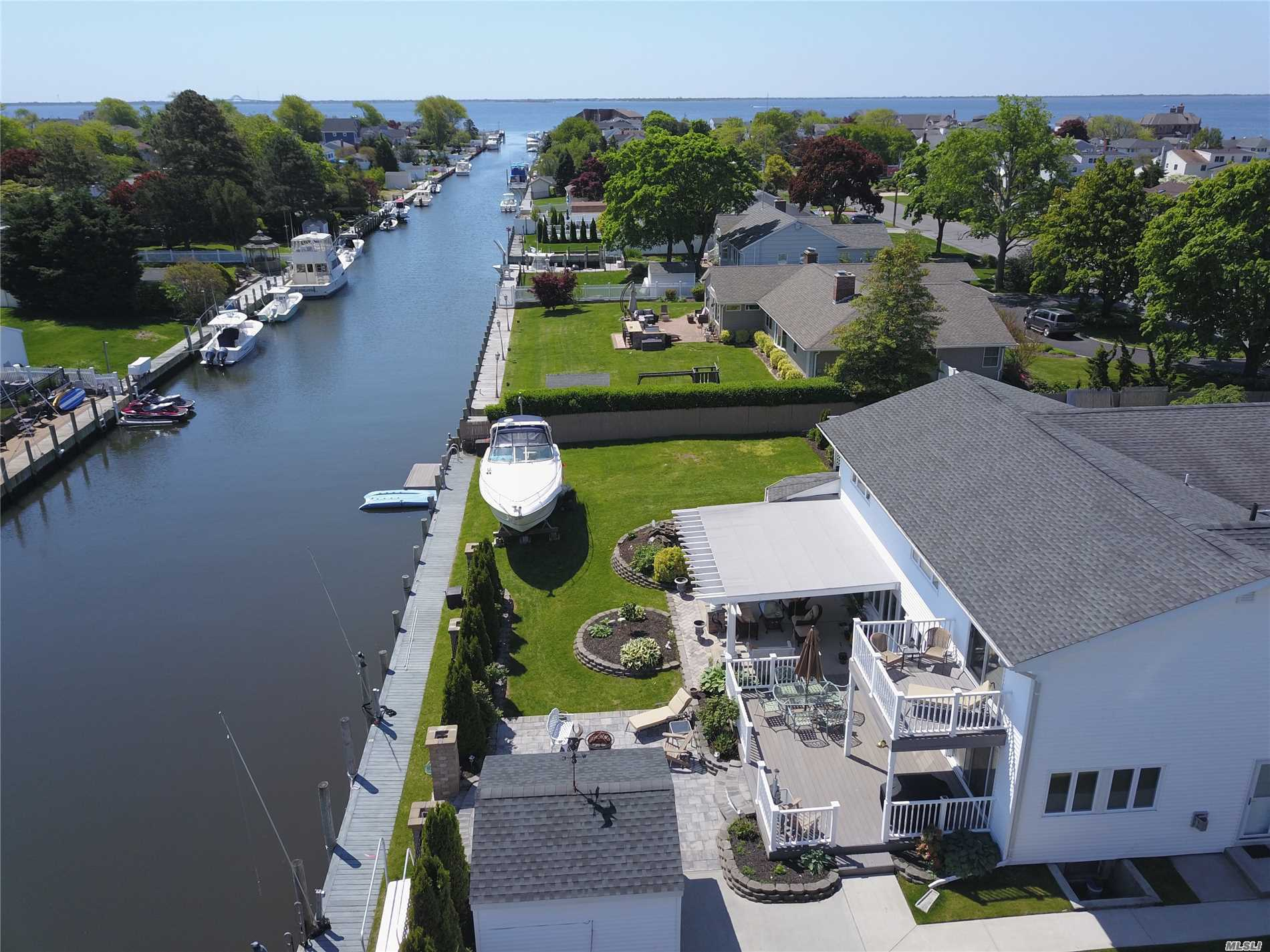 Sunsational Waterfront Gem! 112 Feet Navy Bulk Heading On Magnificently Large Property Located In Desired Willetts Point/West Islip School. Home Boasts Updated Kitchen W/Stainless Steel Appliances, & Granite Counters Open Concept W/Large Dining Rm, & Formal Living Rm. Den W/Gas Fireplace, Mud Rm, Laundry, 2 Car Garage W/Rm For Storage. Master Suite W/Wic & En Suite. Separate Quarters For Nanny Or Grandma . 2nd Floor Includes 4 Brs, Foyer, 2 F Baths & Great Rm/Media Rm.One Beam Constr. Must See!